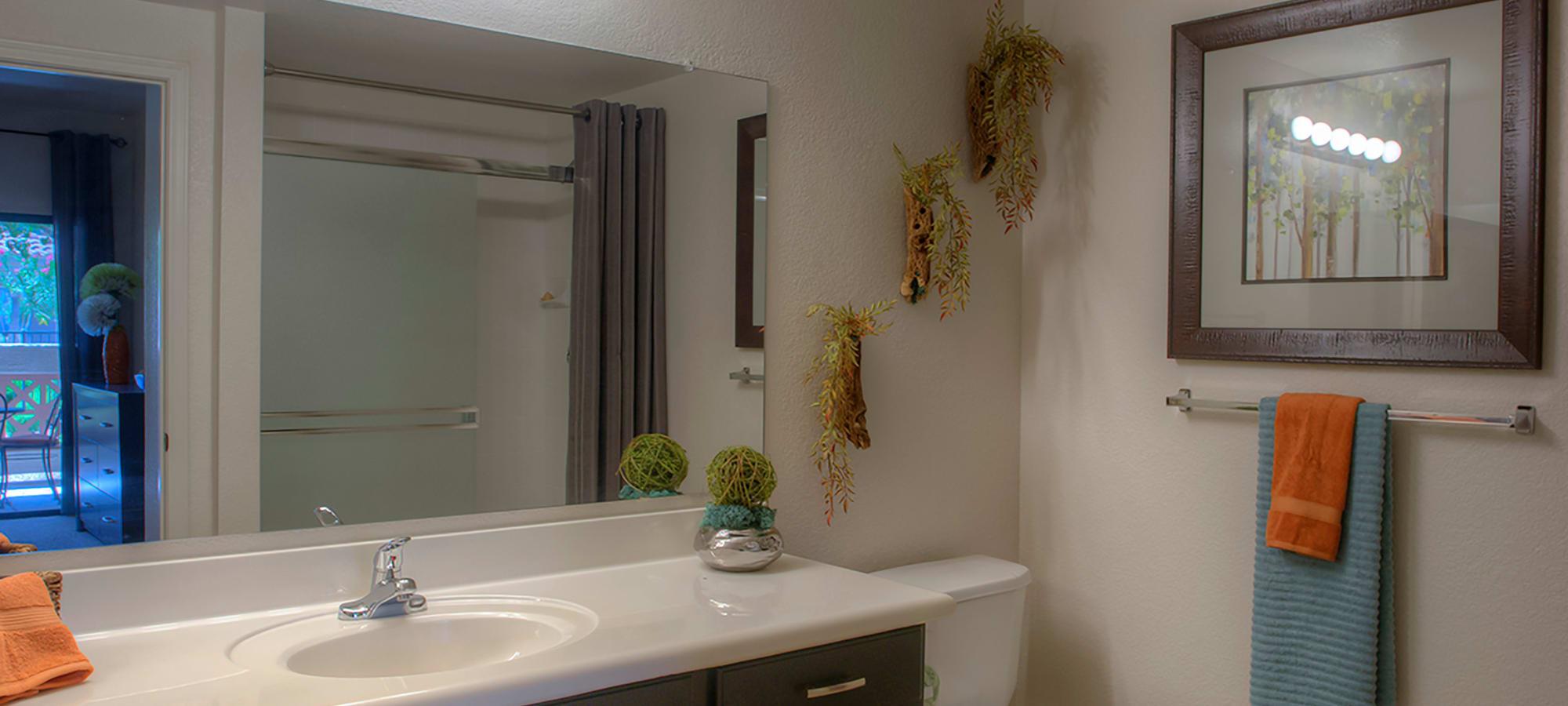Large vanity mirror and granite countertop in a model home's bathroom at San Pedregal in Phoenix, Arizona