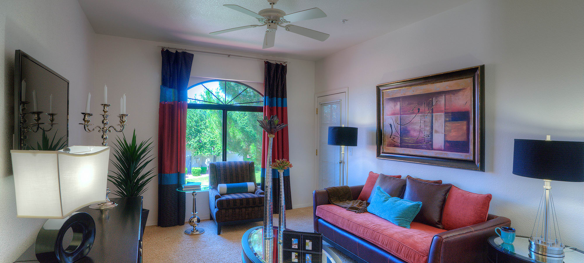 Living room with patio access at San Cervantes in Chandler, Arizona