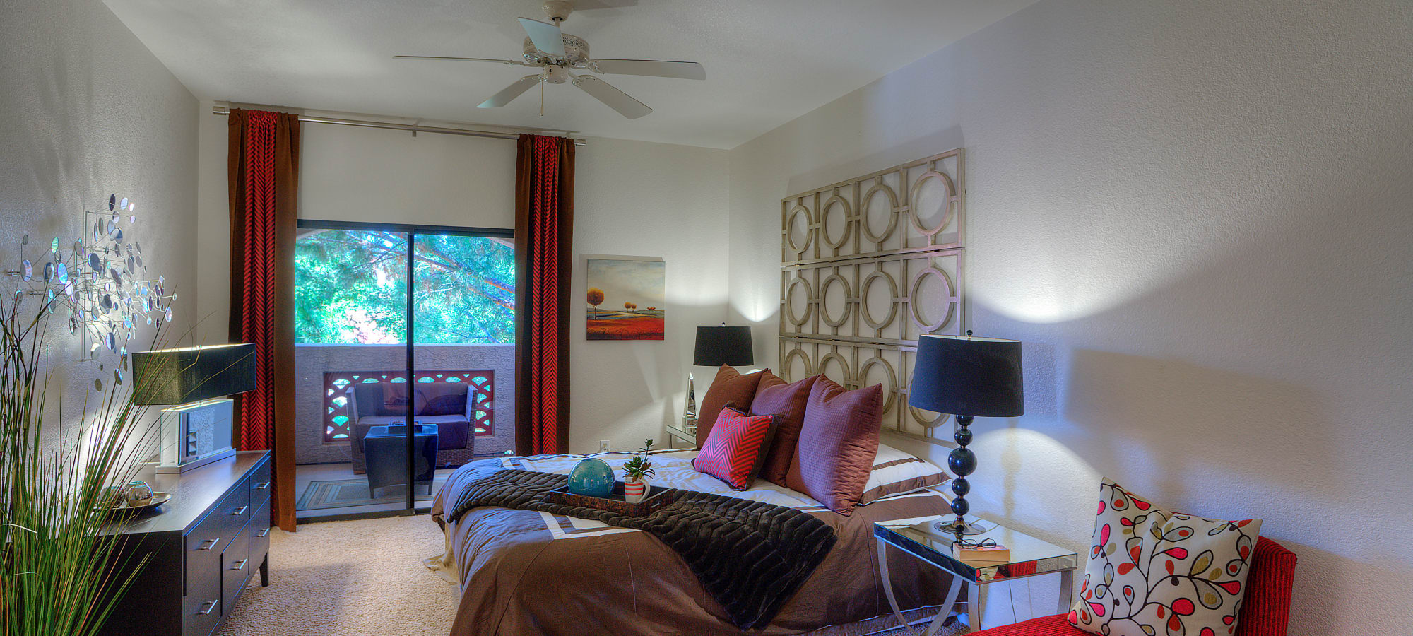 Master bedroom with private balcony at San Cervantes in Chandler, Arizona