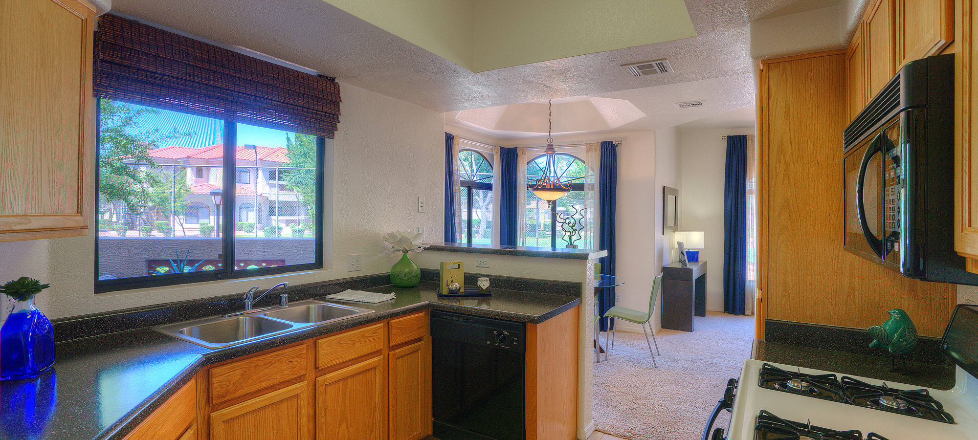 Kitchen with a window at San Cervantes in Chandler, Arizona