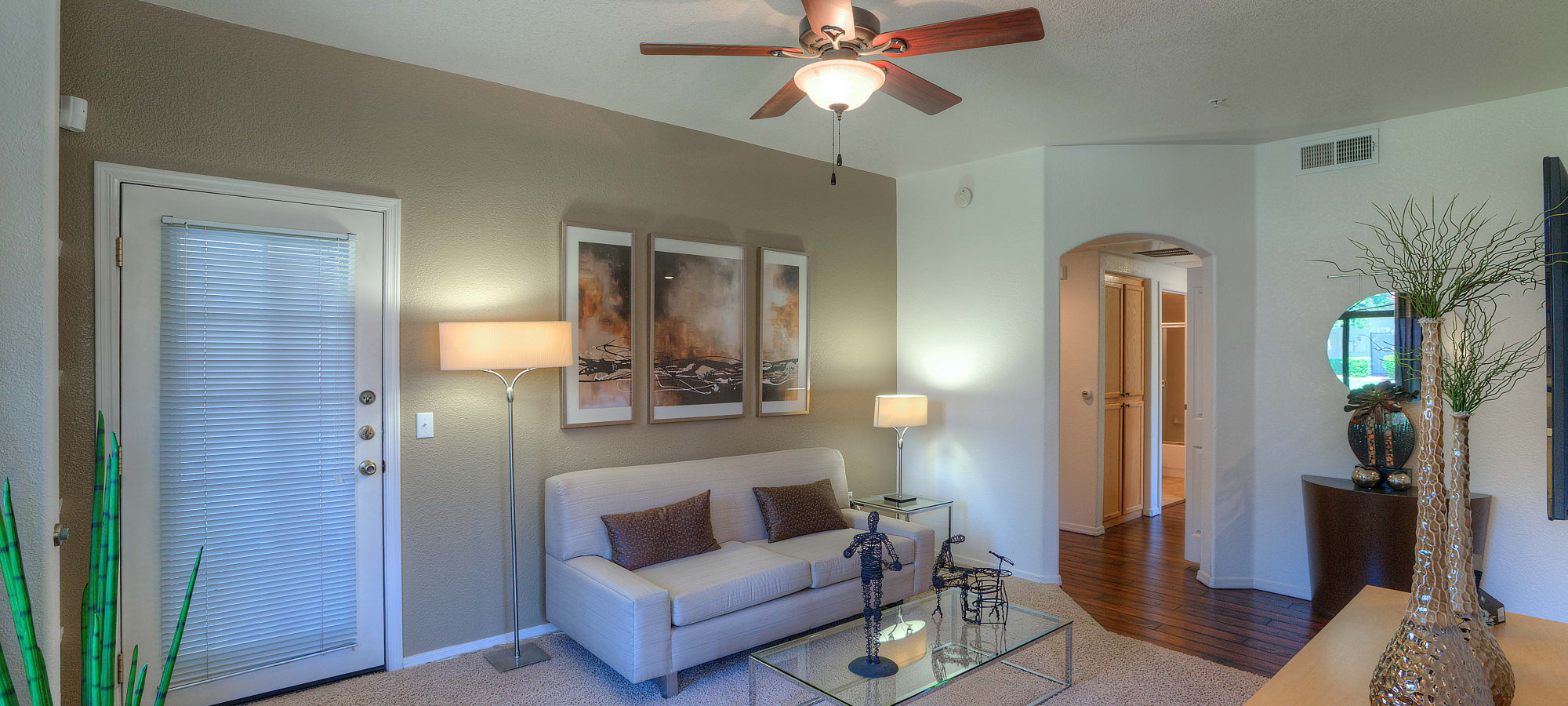 Large living room with a ceiling fan at San Cervantes in Chandler, Arizona