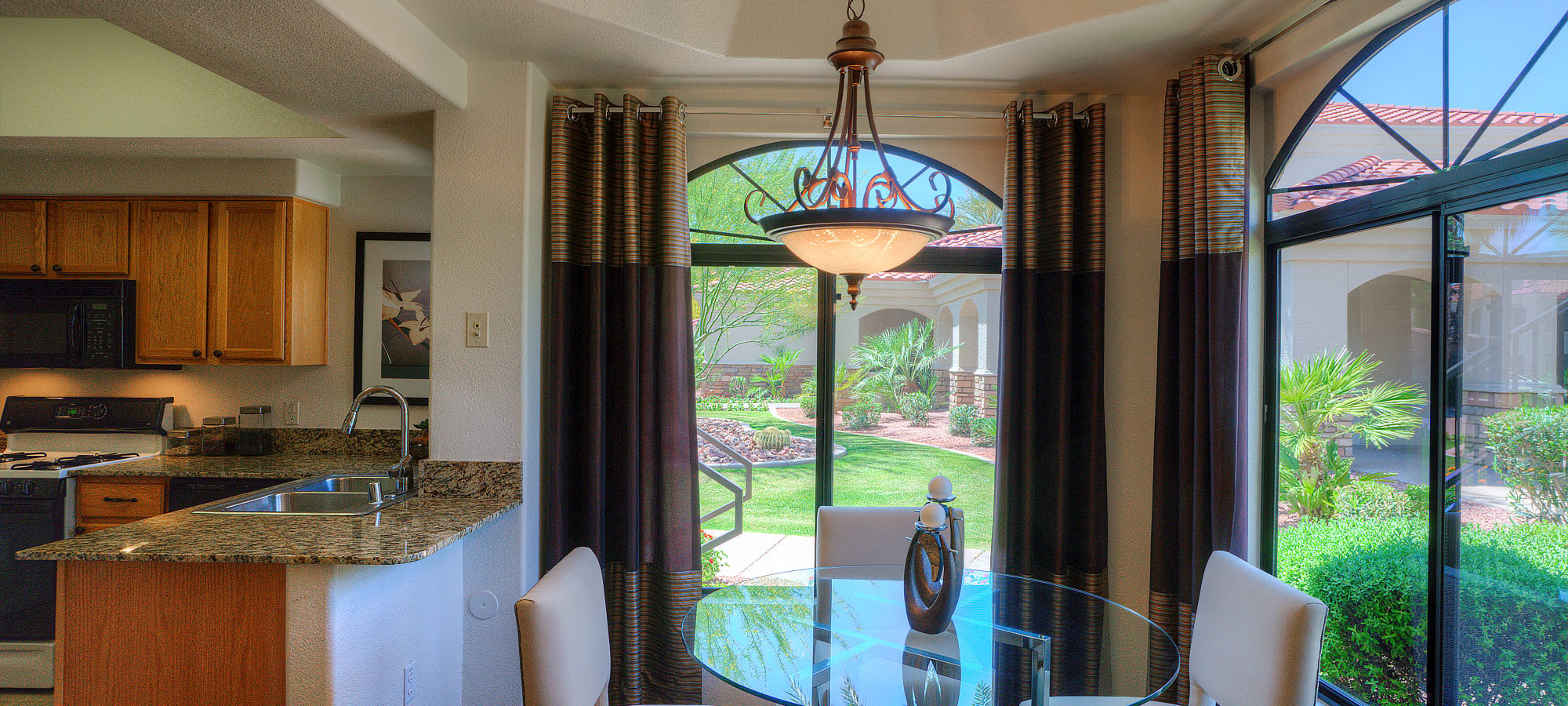 Dining room with large windows at San Cervantes in Chandler, Arizona