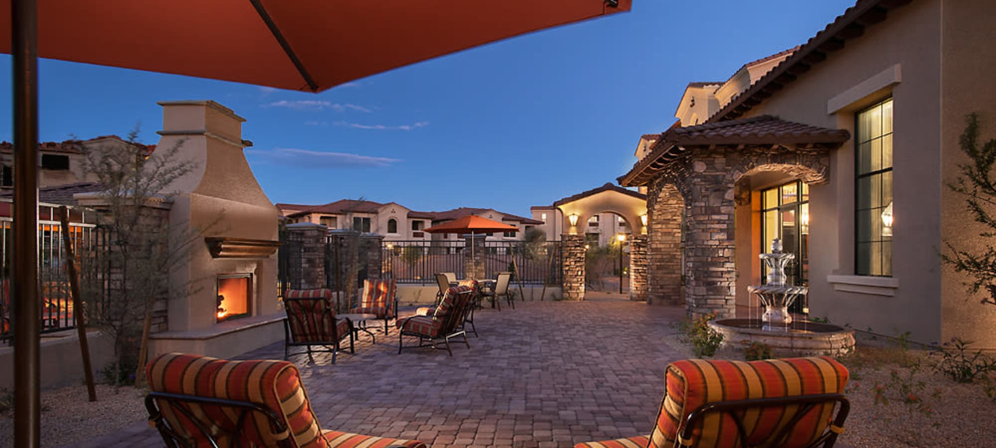 Community patio with outdoor fireplace at San Norterra in Phoenix, Arizona