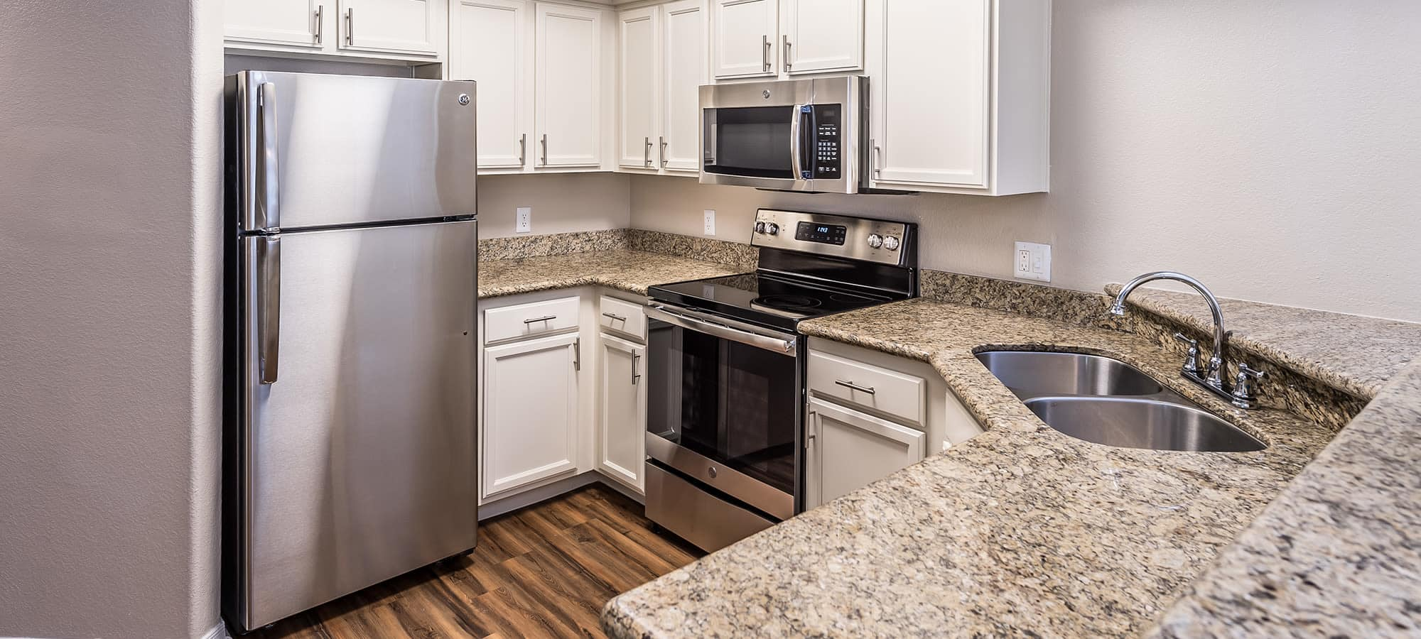 Beautiful kitchen with stainless-steel appliances at San Palmas in Chandler, Arizona
