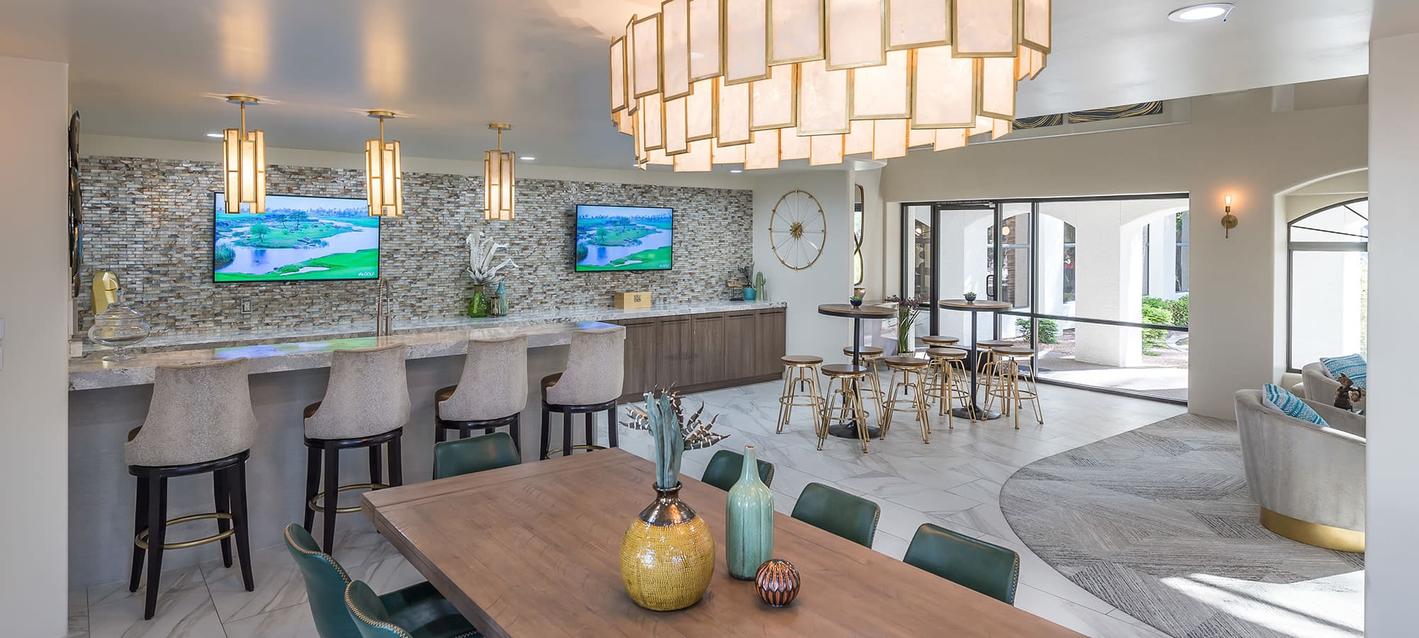 Luxury clubhouse with TVs and bar seating at San Palmas in Chandler, Arizona