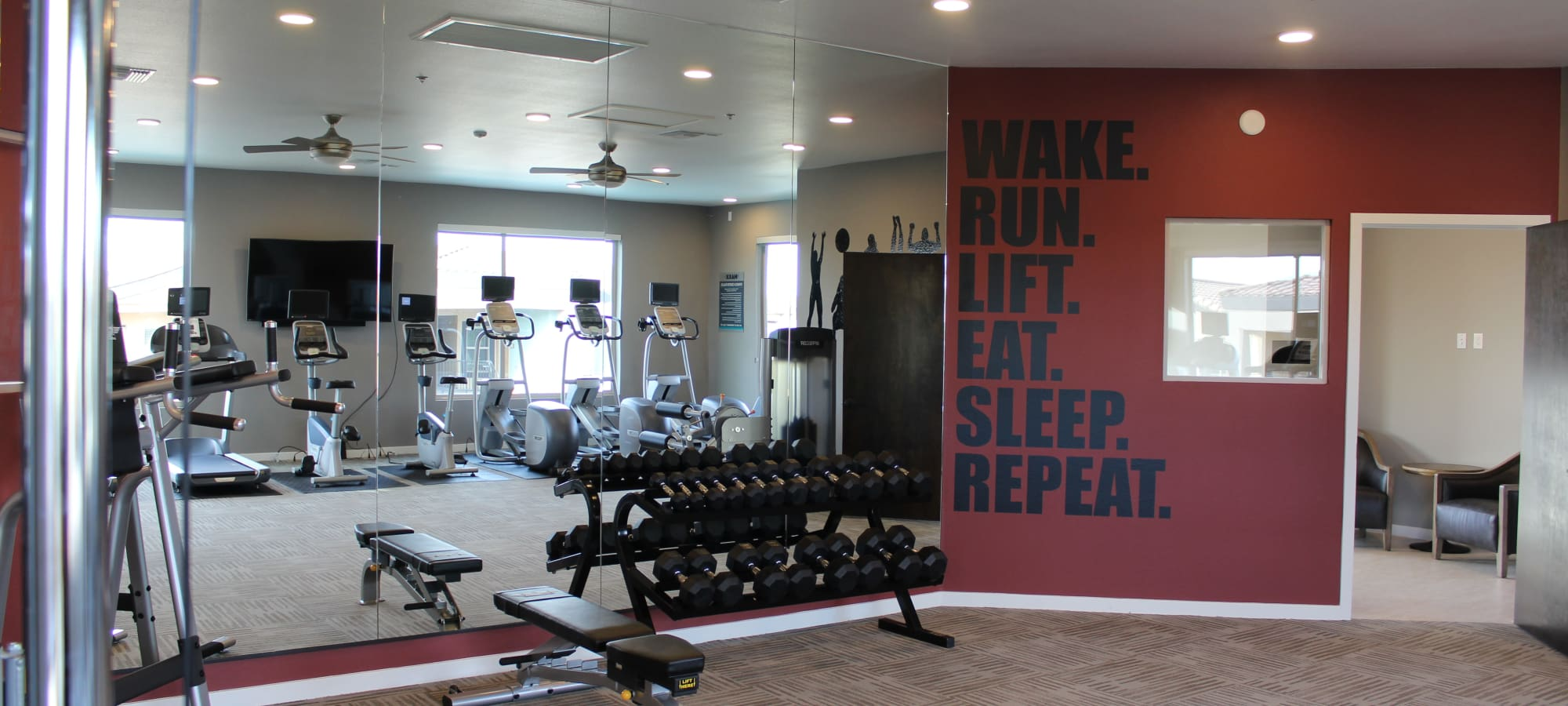 Gym with inspiring quote on the wall at The Maxx 159 in Goodyear, Arizona