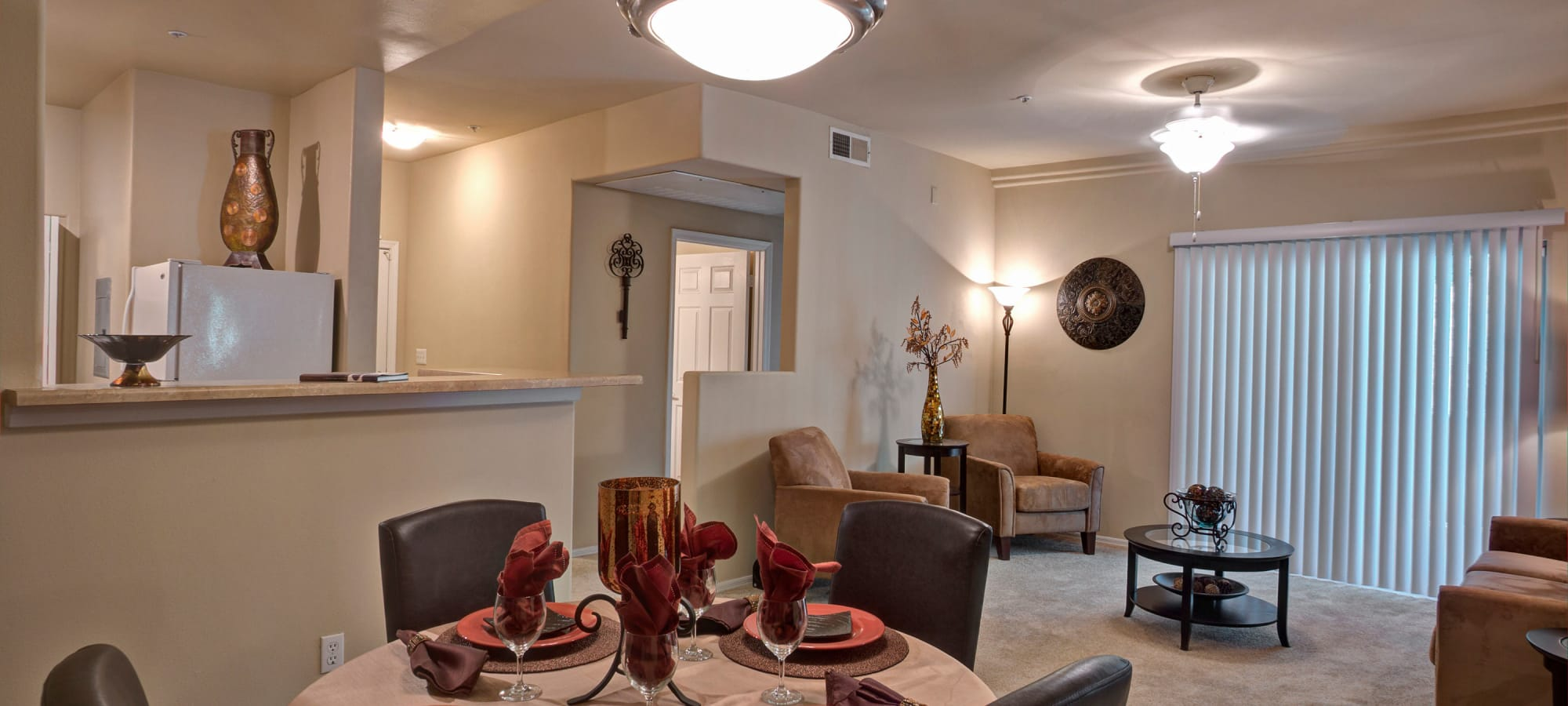 Beautiful dining room with living room in model home at The Regents at Scottsdale in Scottsdale, Arizona