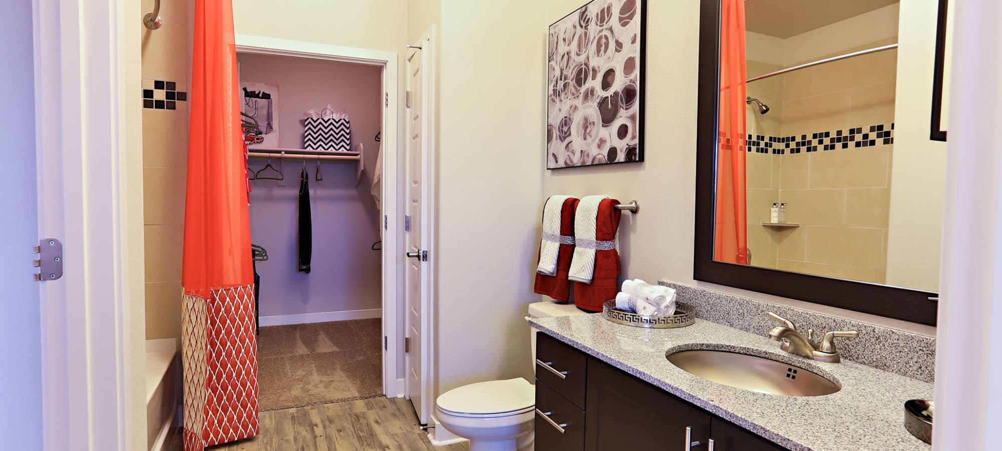 Large bathroom with adjacent walk-in closet in model home at The Hyve in Tempe, Arizona