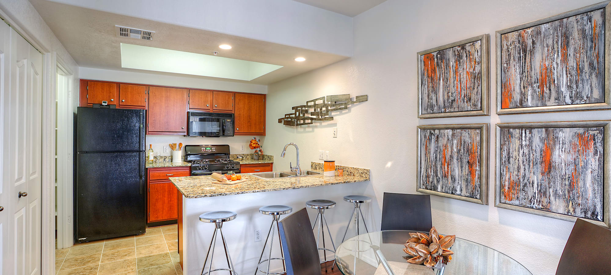 Kitchen with custom cabinetry and breakfast bar at San Palacio in Chandler, Arizona