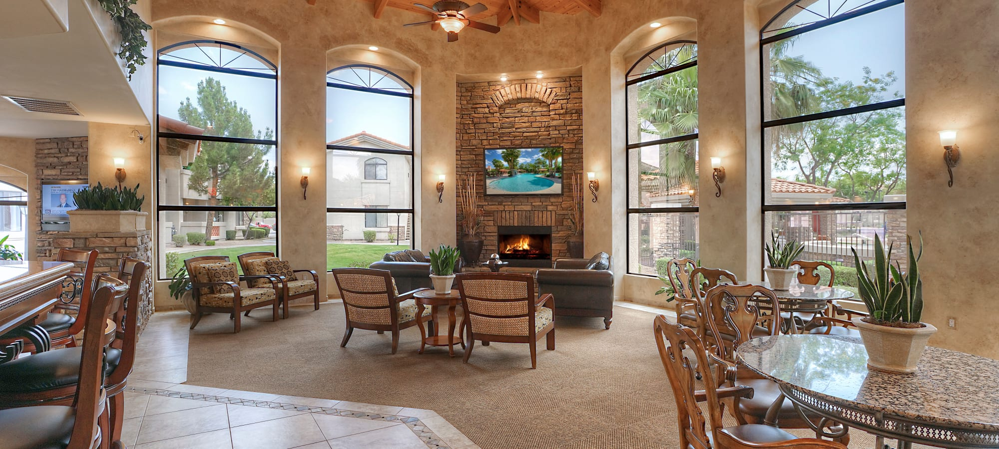 Comfortable clubhouse setting with seating and TVs at San Palacio in Chandler, Arizona