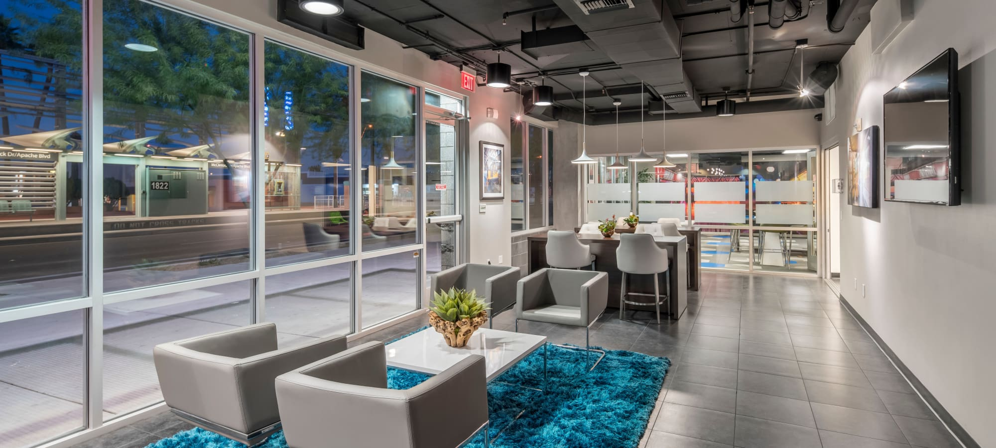 Community clubhouse with comfortable lounge seating at Tempe Metro in Tempe, Arizona