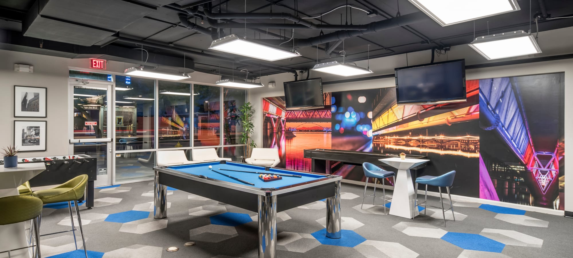 Community lounge with pool table at Tempe Metro in Tempe, Arizona