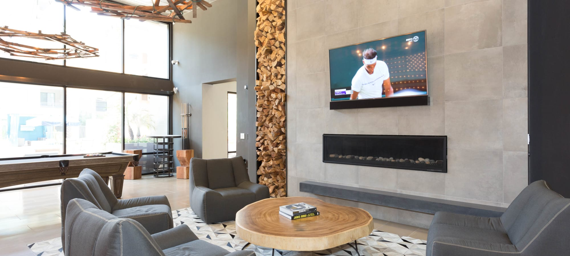 Comfortable seating in front of the fireplace in the lobby at Avant at Fashion Center in Chandler, Arizona