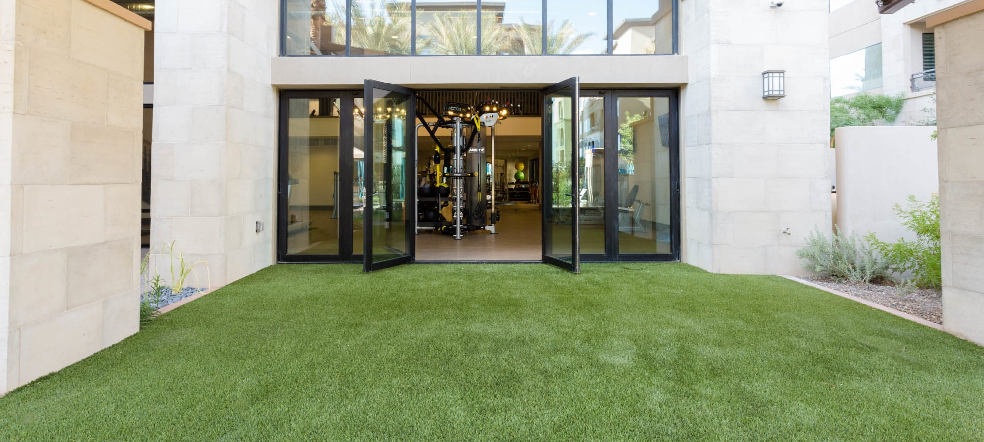 Yoga lawn outside the fitness center at Avant at Fashion Center in Chandler, Arizona