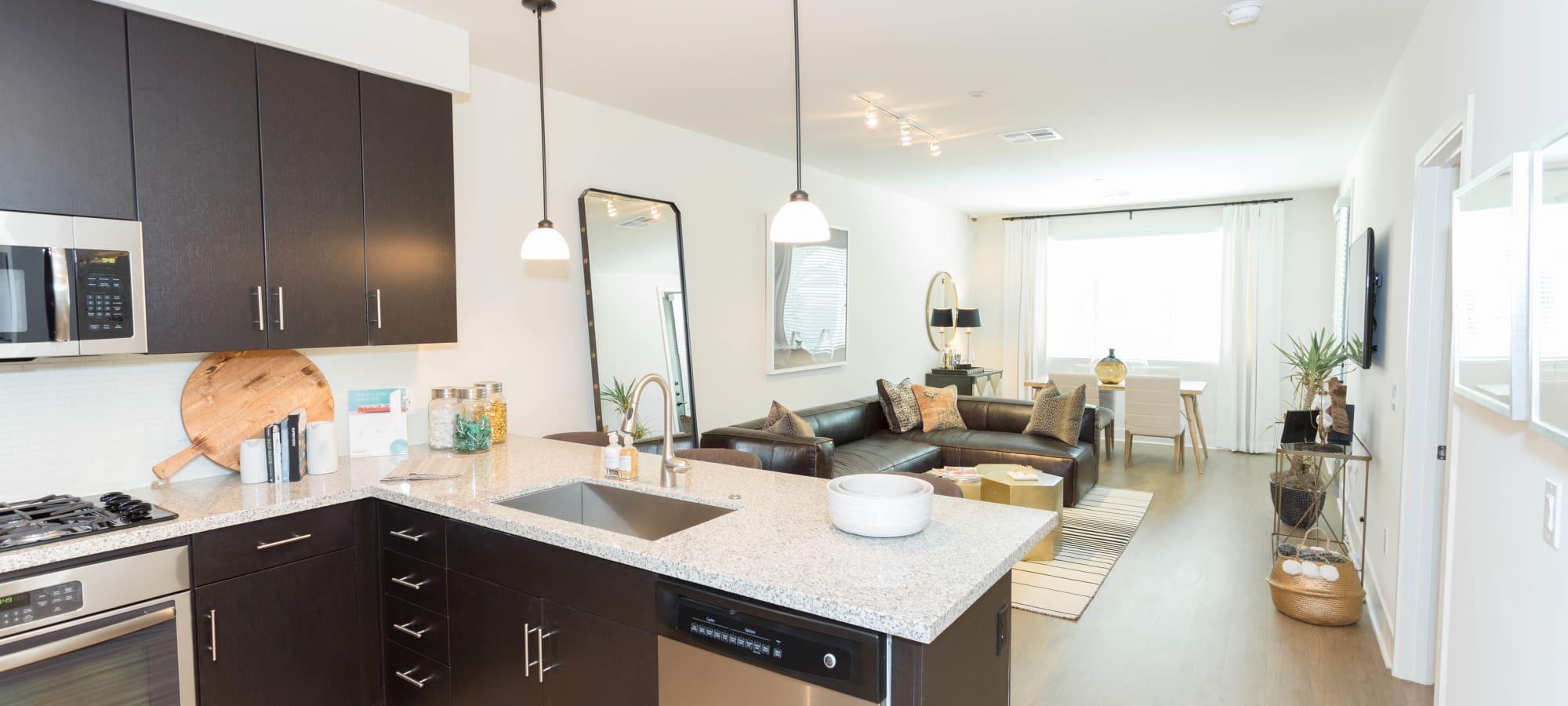 Granite countertops in model home's kitchen at Avant at Fashion Center in Chandler, Arizona