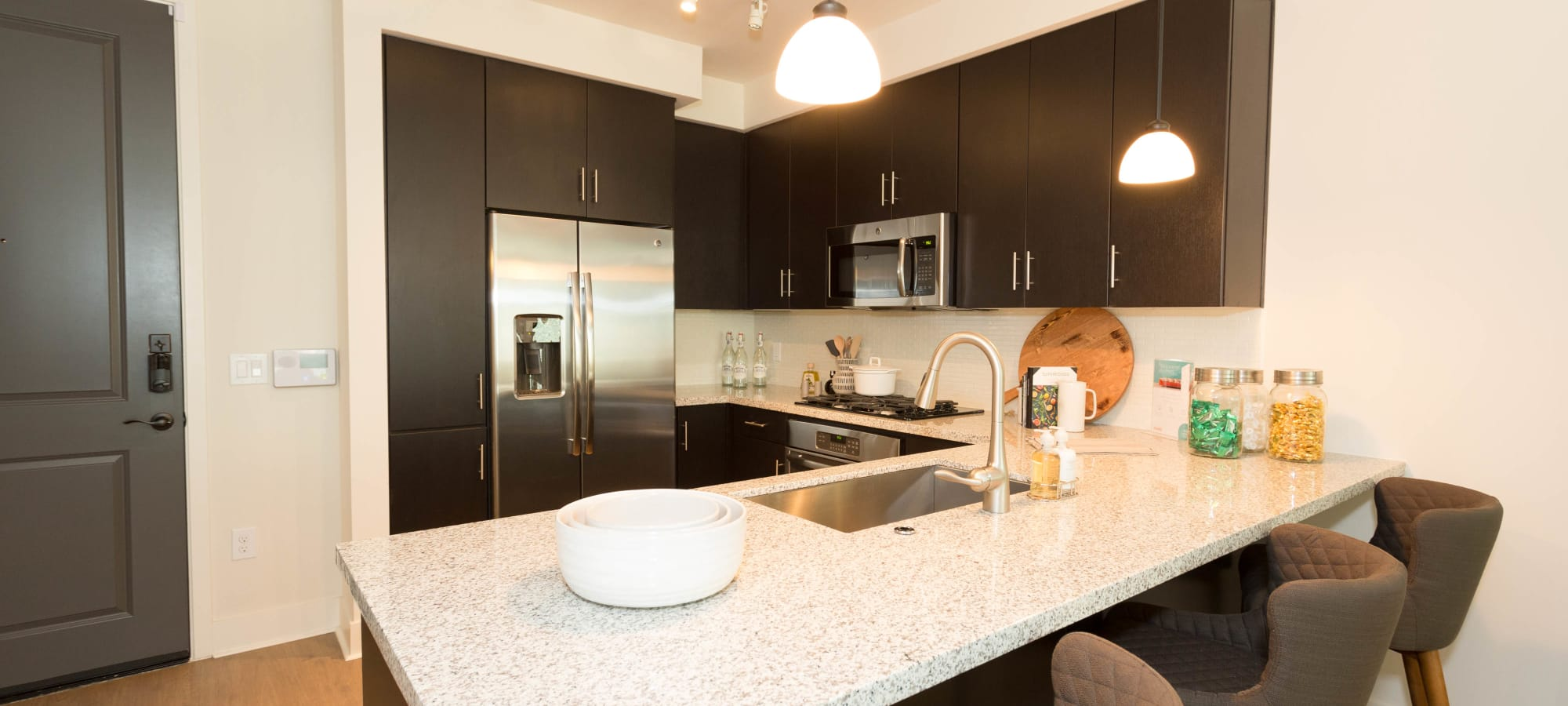 Stainless-steel appliances in model home's kitchen at Avant at Fashion Center in Chandler, Arizona