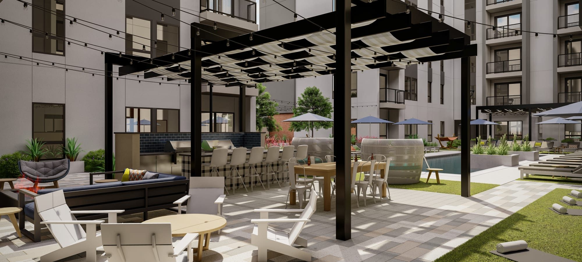 Extensive outdoor grill station with bar seating at The Astor at Osborn in Phoenix, Arizona