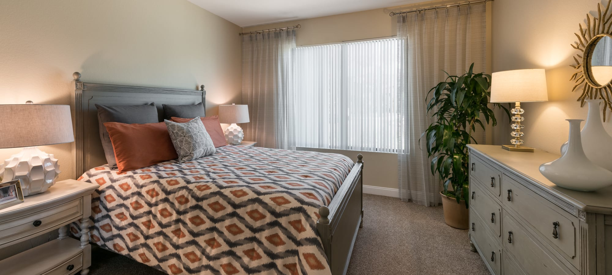 Well-decorated guest bedroom in model home at San Piedra in Mesa, Arizona