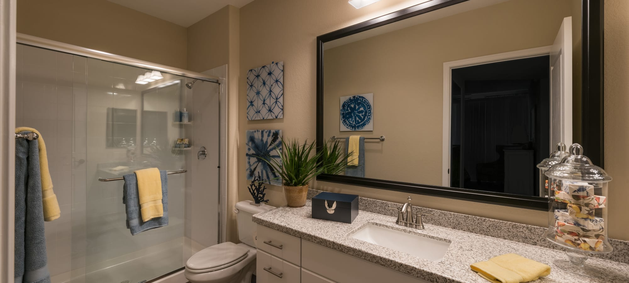 Well-lit master bathroom with granite countertop in model home at San Piedra in Mesa, Arizona