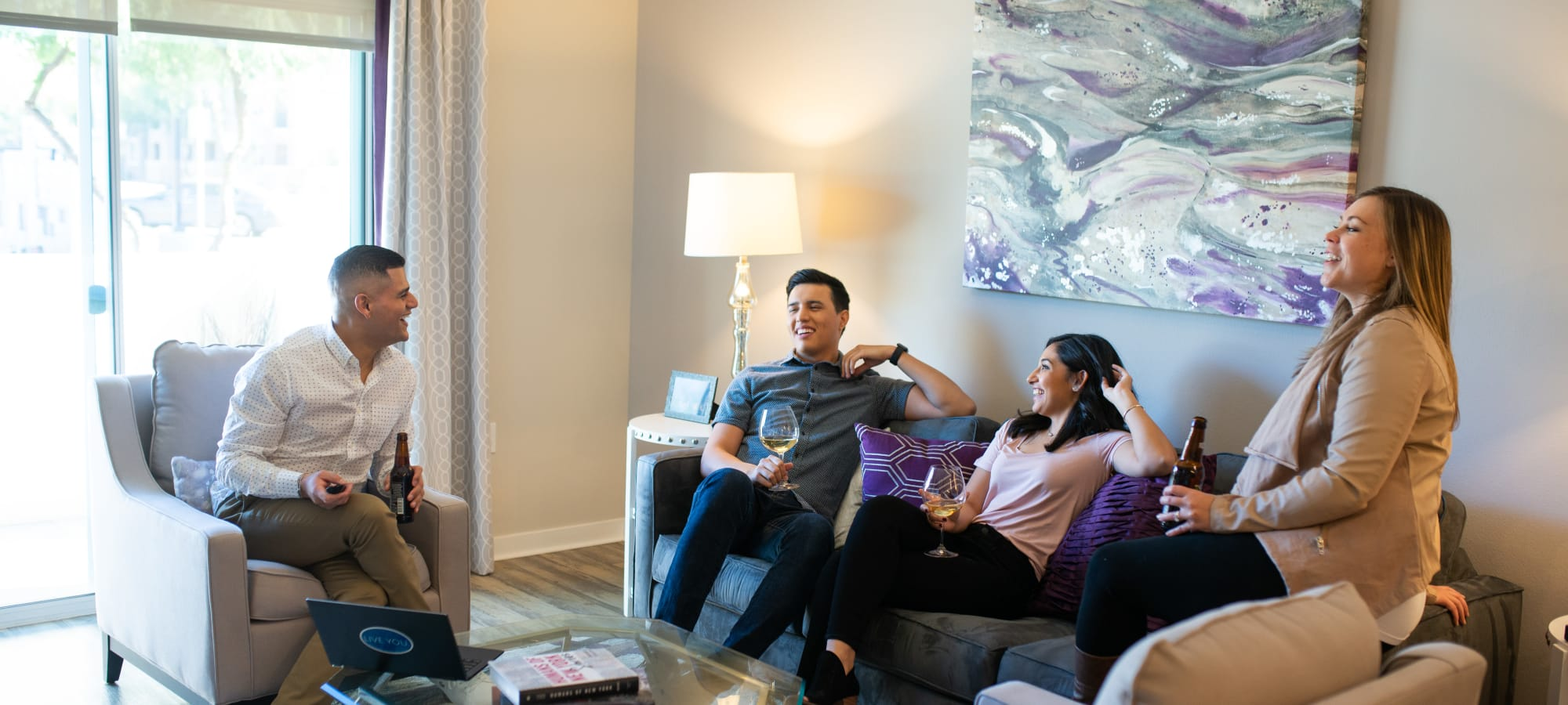 Residents enjoying wine in their new living room at The Astor at Osborn in Phoenix, Arizona