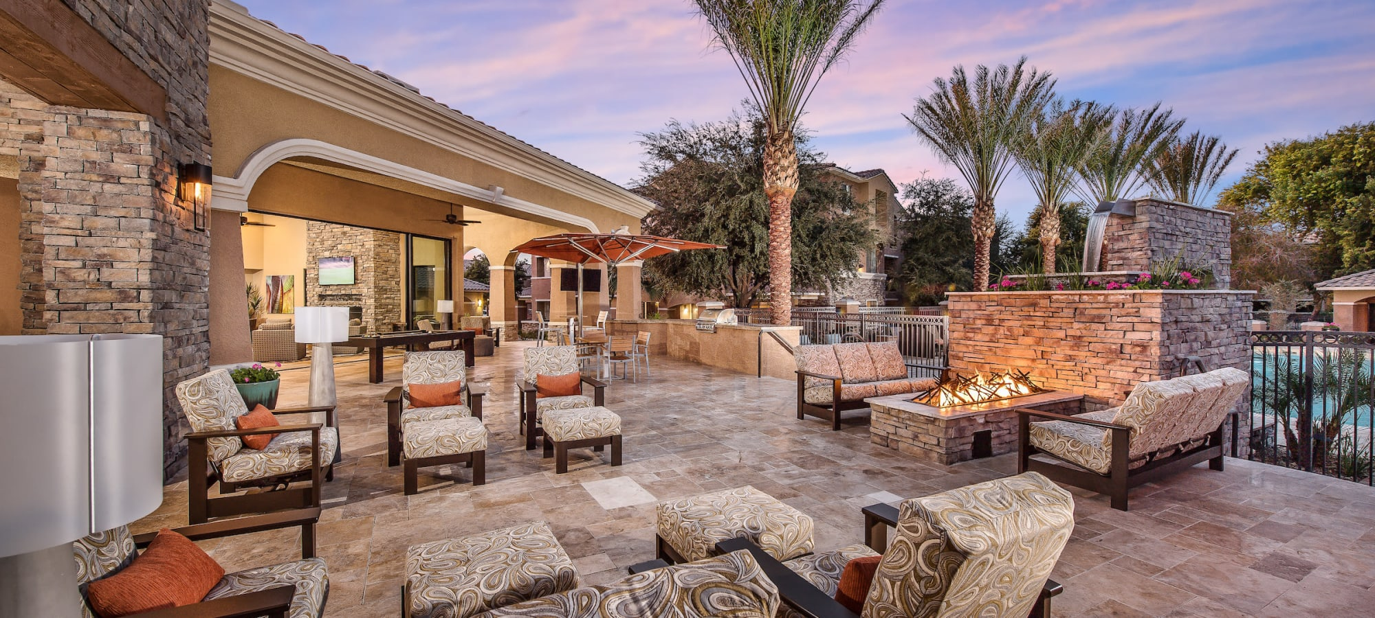 Lounge seating at the outdoor fireplace at Stone Oaks in Chandler, Arizona