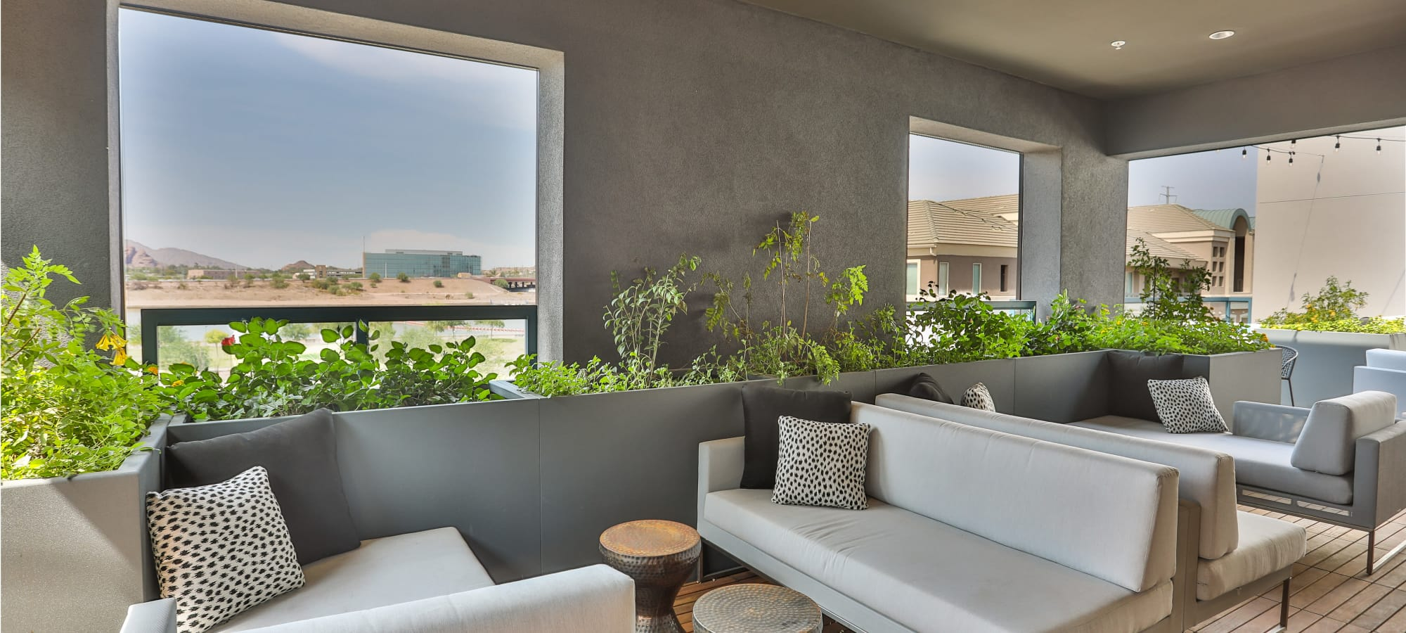 Covered rooftop seating with a gorgeous view at Lakeside Drive Apartments in Tempe, Arizona