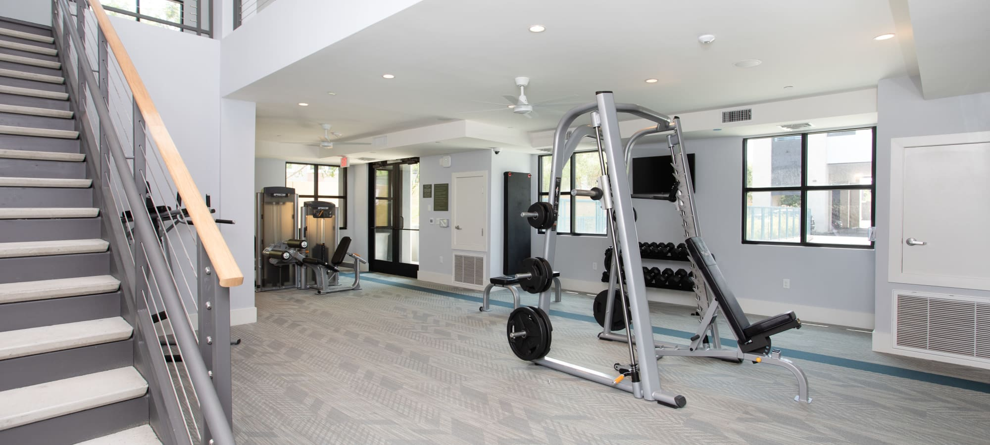 Weight-lifting equipment at Lakeside Drive Apartments in Tempe, Arizona
