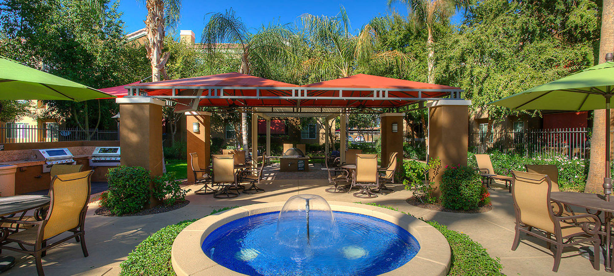 Outdoor dining tables seated around a water fountain at Park on Bell in Phoenix, Arizona