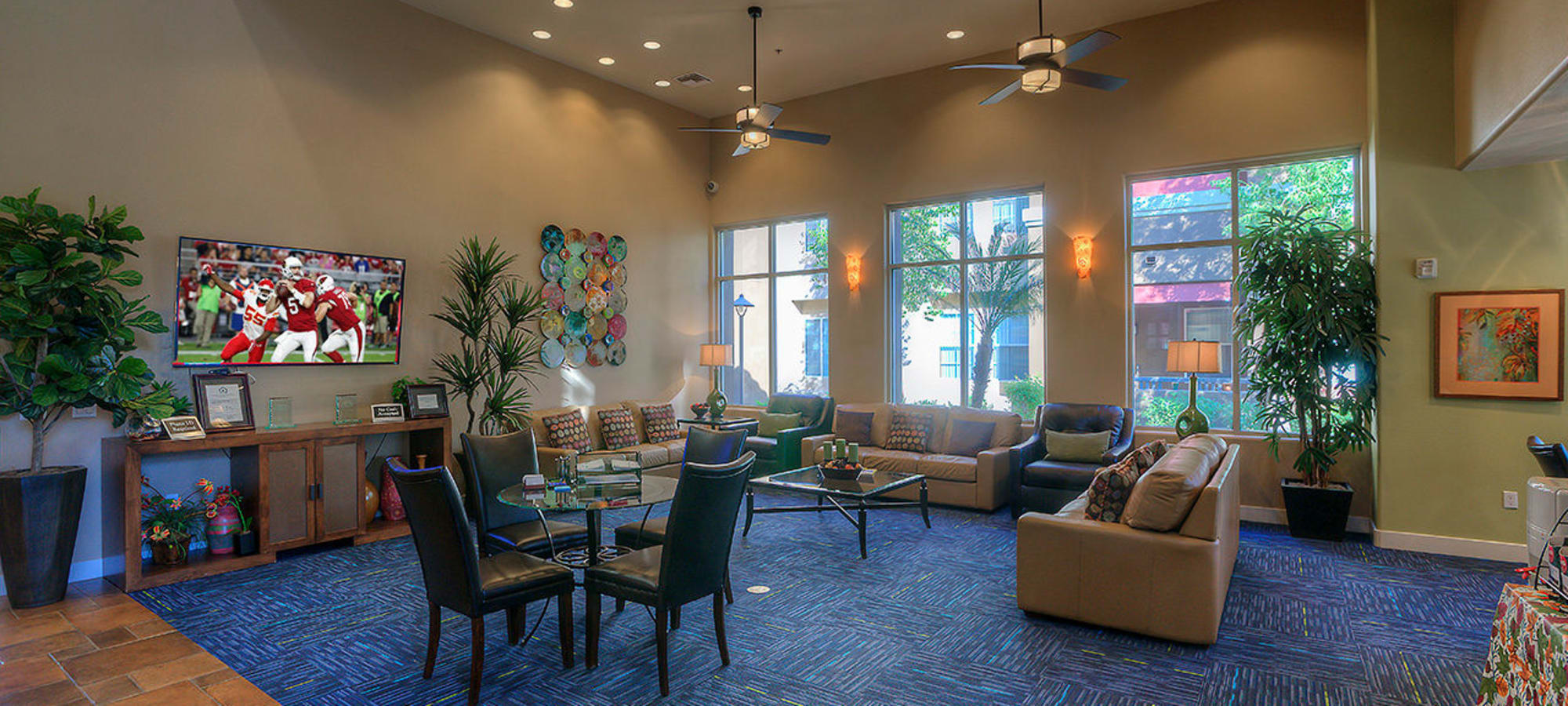 Community clubhouse with flat-screen TV at Park on Bell in Phoenix, Arizona