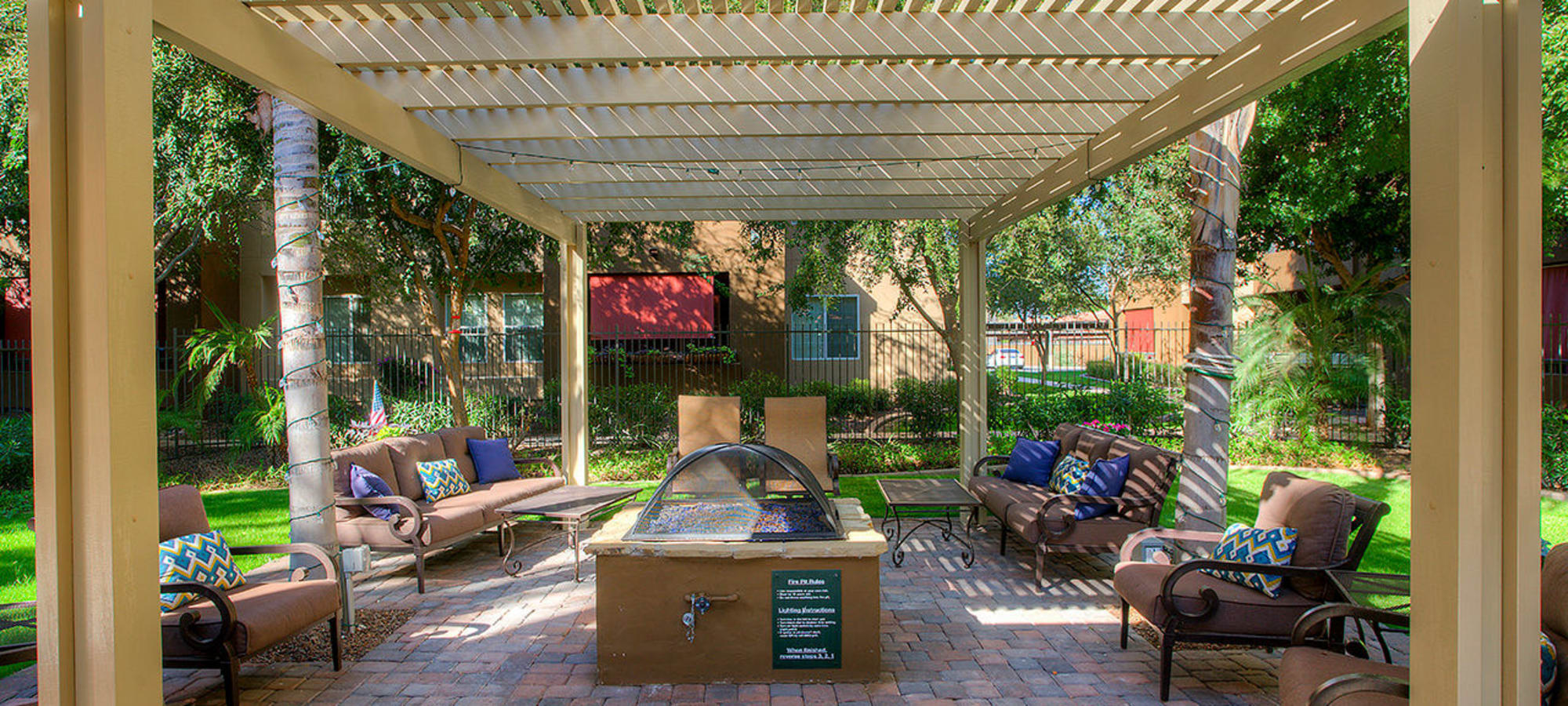 Shaded seating around a fire pit at Park on Bell in Phoenix, Arizona