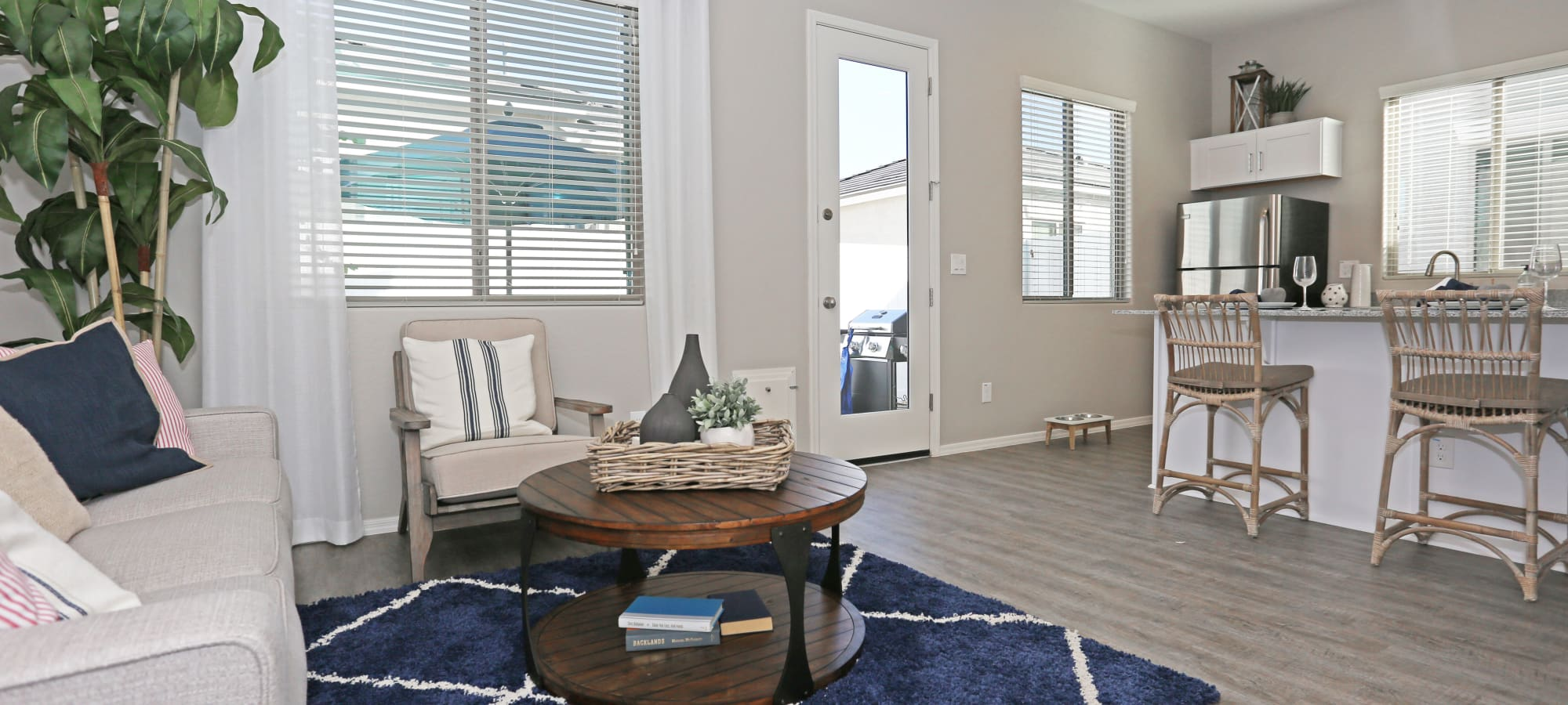 Comfortable living room in model home at Christopher Todd Communities At Stadium in Glendale, Arizona