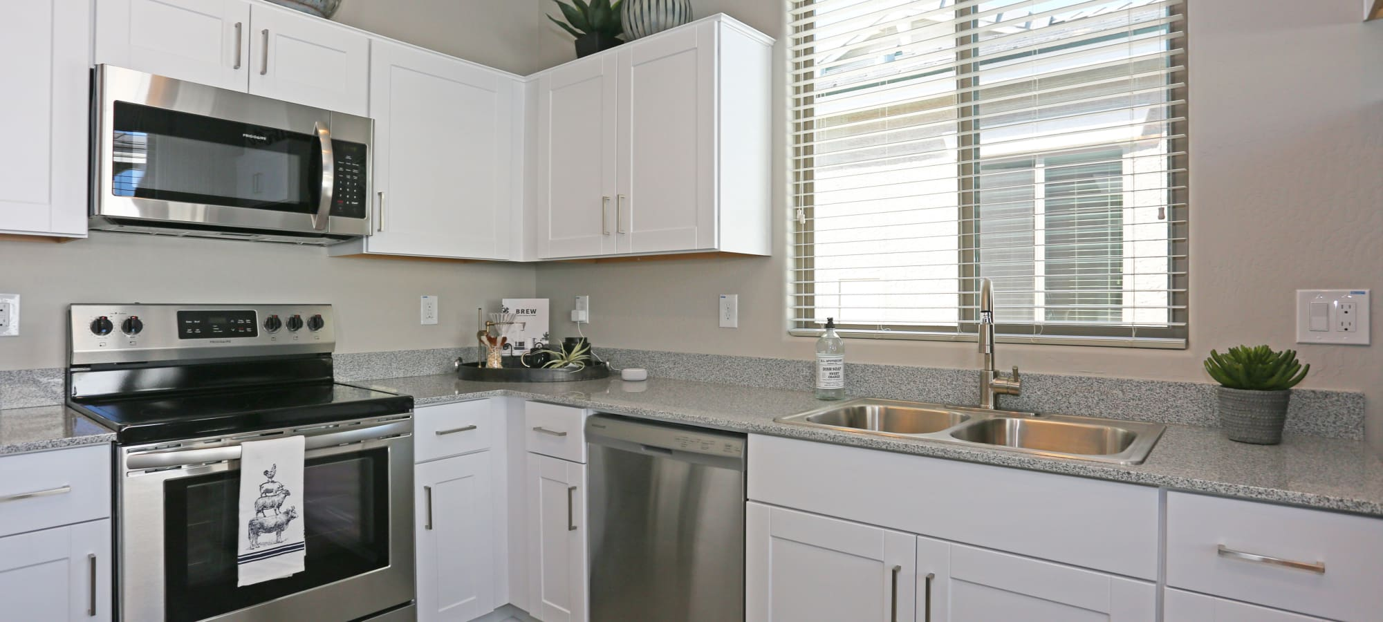 White cabinetry in kitchen of model home at Christopher Todd Communities On Camelback in Litchfield Park, Arizona