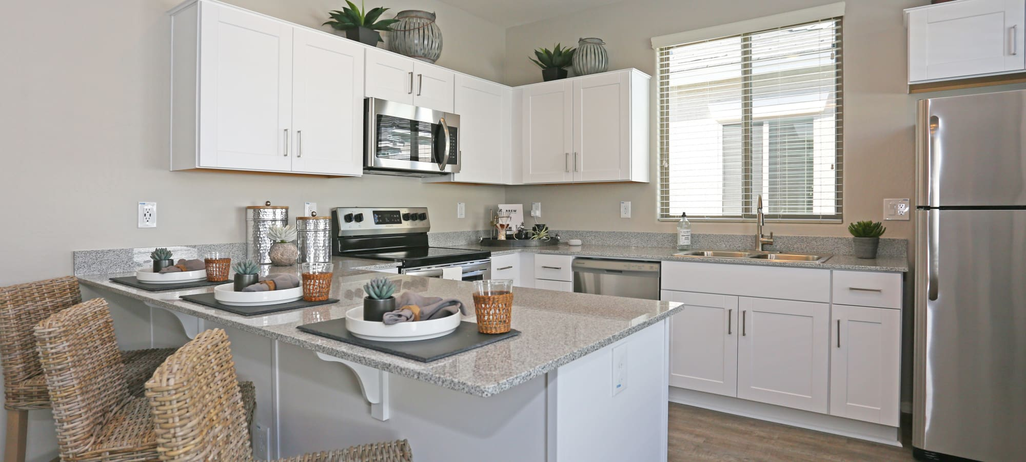 Granite countertops in model home's kitchen at Christopher Todd Communities At Stadium in Glendale, Arizona