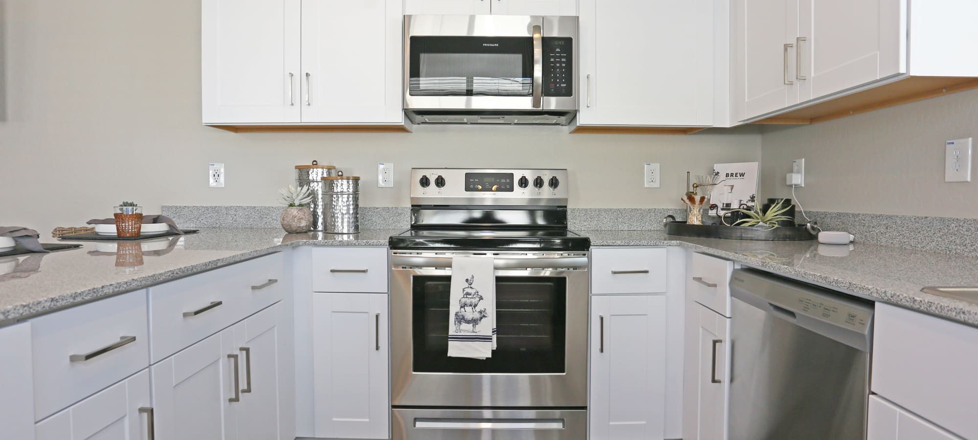Stainless-steel appliances in model home's kitchen at Christopher Todd Communities On Camelback in Litchfield Park, Arizona