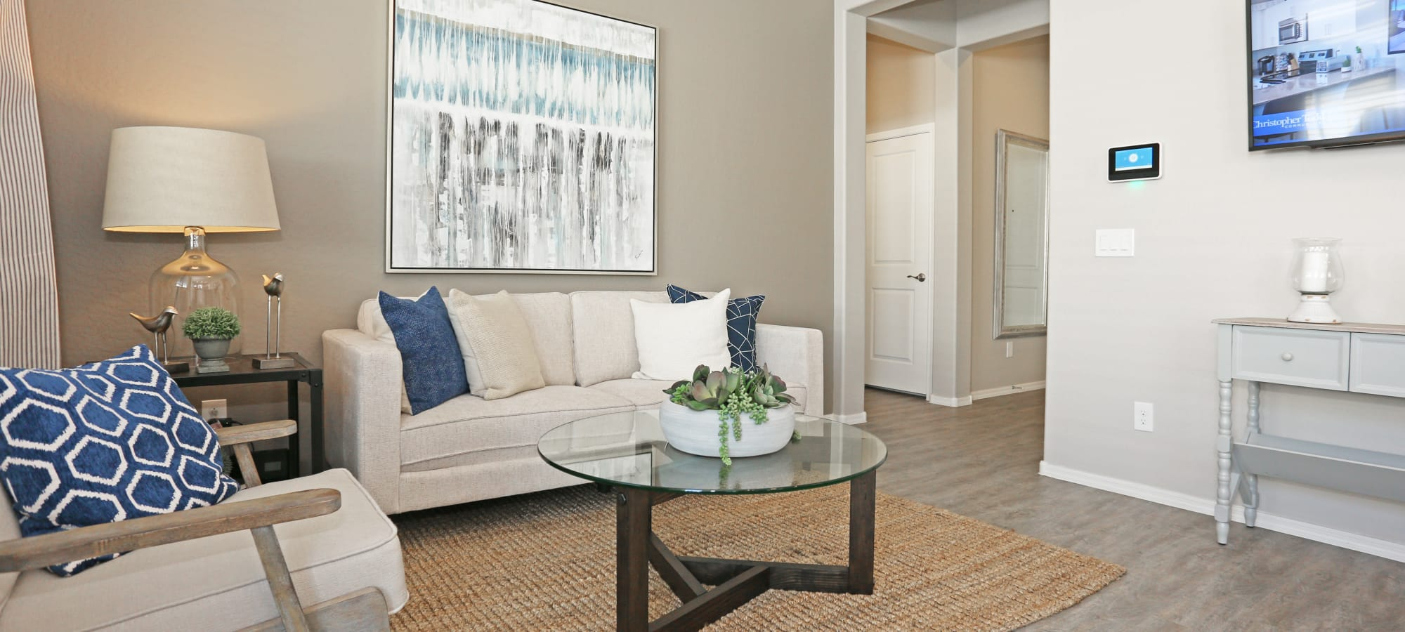 Comfortably decorated living area in model home at Christopher Todd Communities At Stadium in Glendale, Arizona
