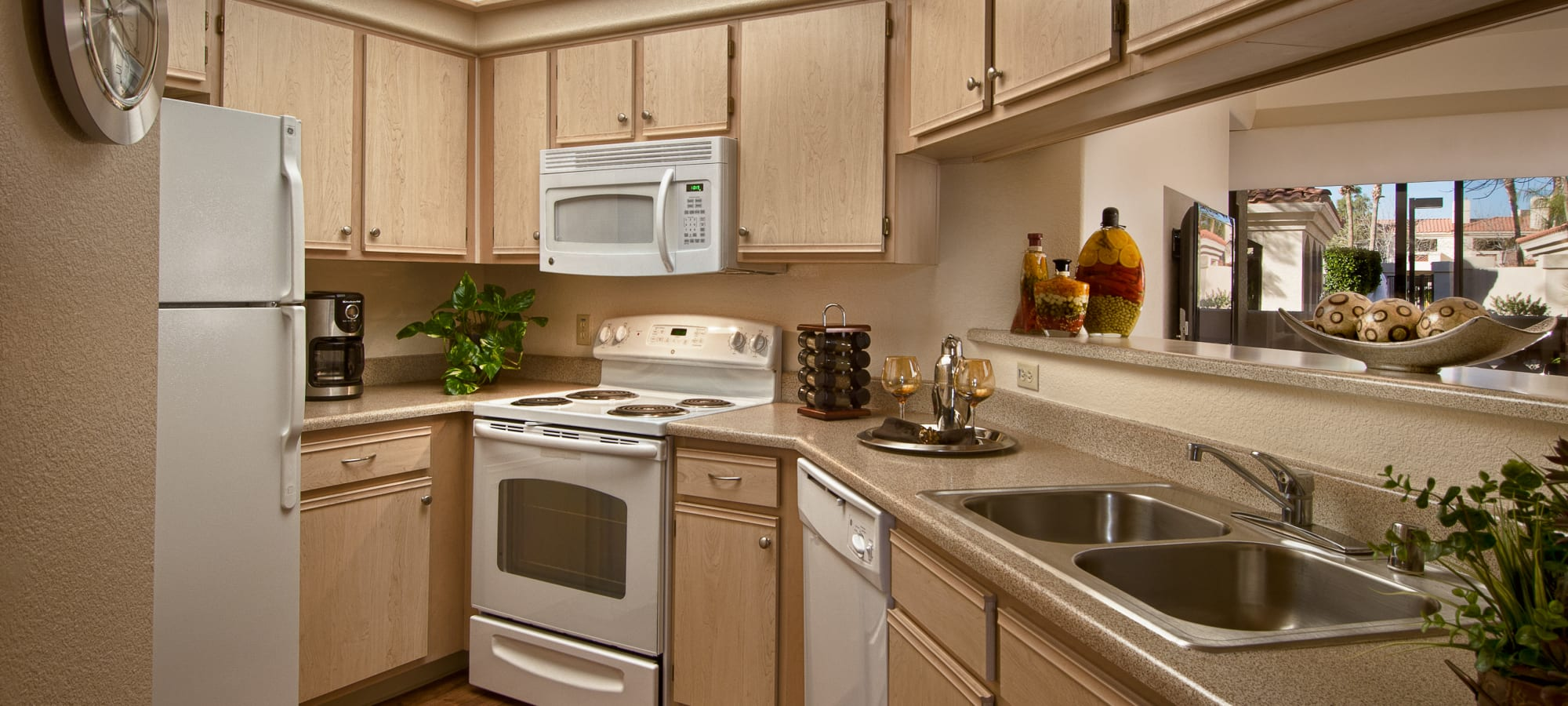 Granite countertops and a light color scheme in a model home's kitchen at San Palmilla in Tempe, Arizona