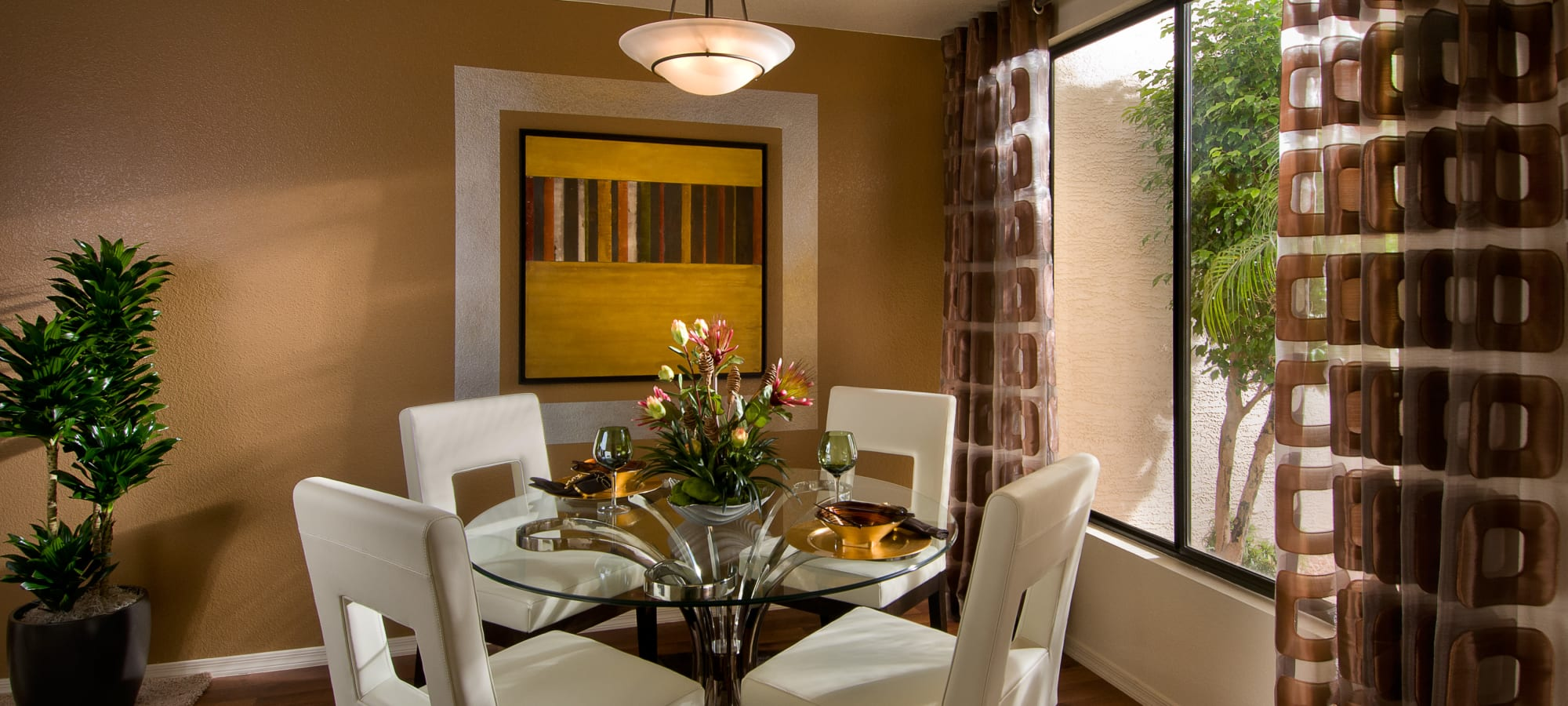 Dining nook with a view outside in a model home at San Palmilla in Tempe, Arizona