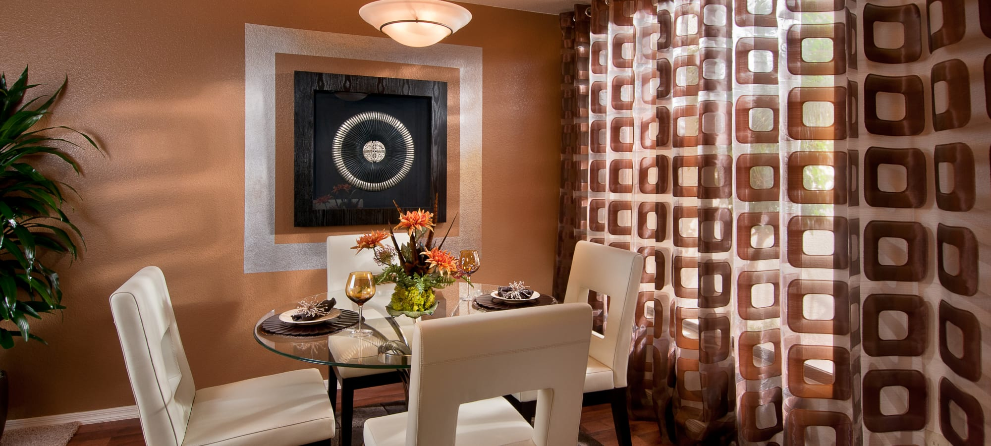 Contemporary decor and an accent wall in a model home's dining area at San Palmilla in Tempe, Arizona