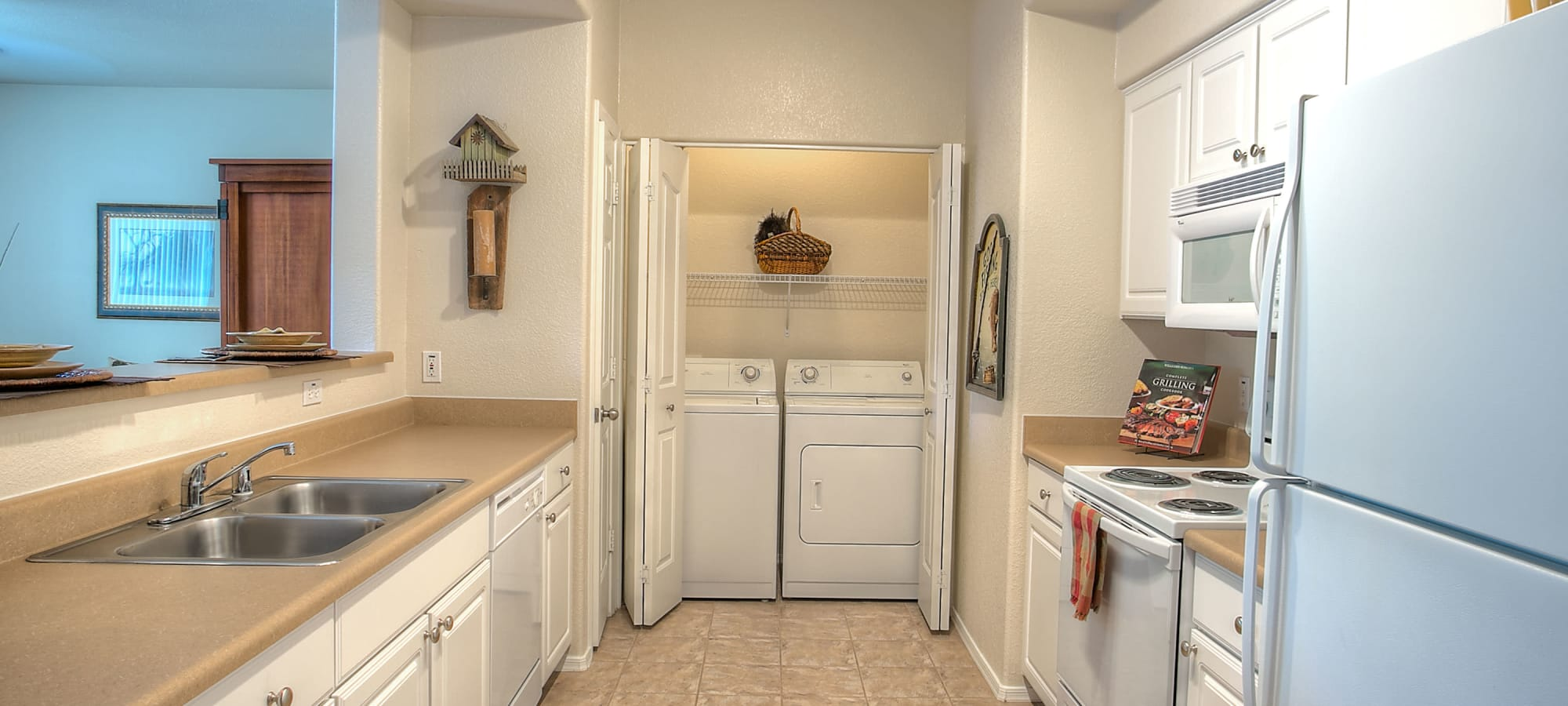 Kitchen leading into the washer and dryer at Remington Ranch in Litchfield Park, Arizona