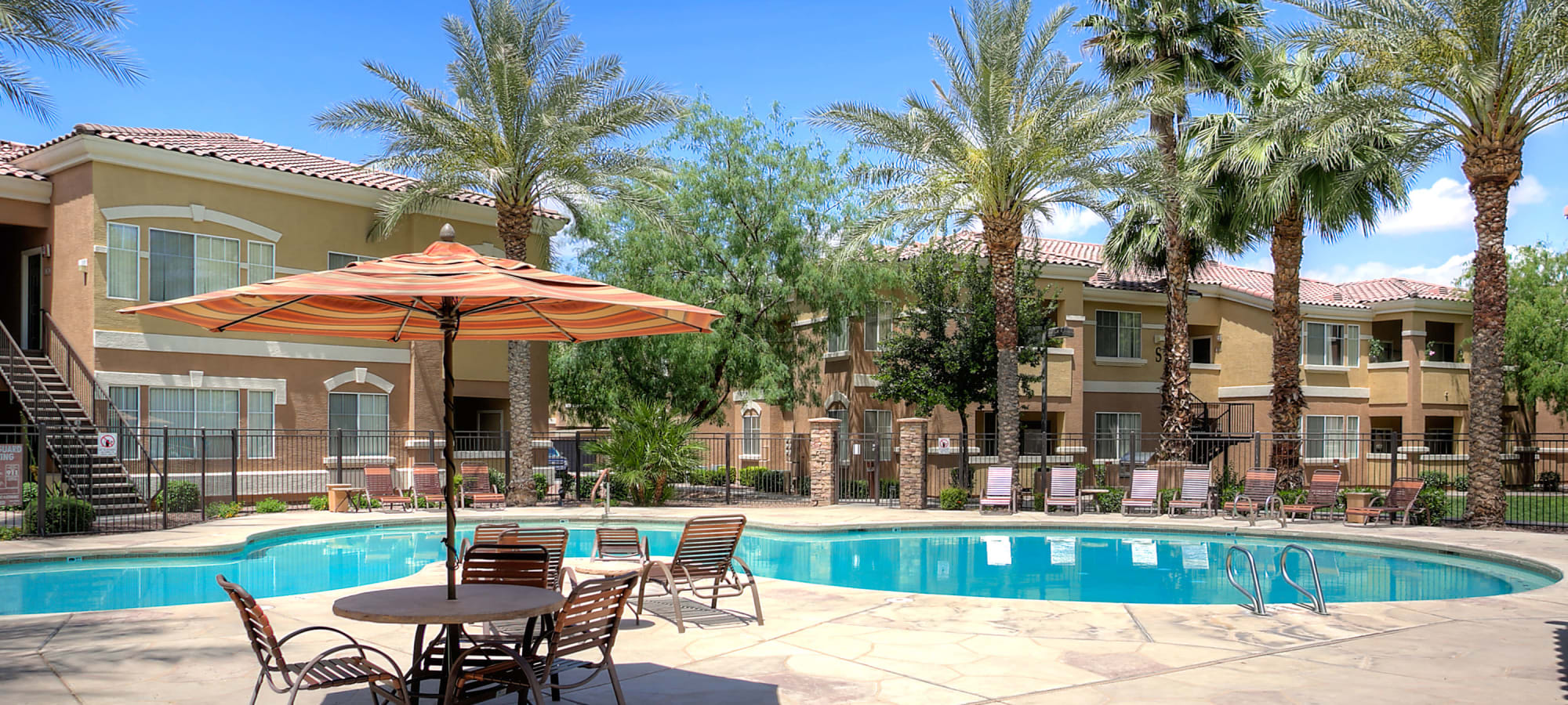 Resort style swimming pool on a beautiful day at Remington Ranch in Litchfield Park, Arizona