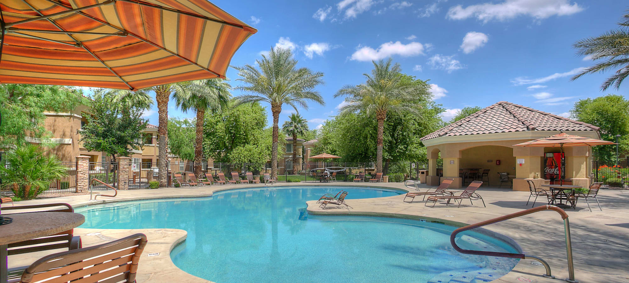 Resort style swimming pool with covered lounge chairs at Remington Ranch in Litchfield Park, Arizona