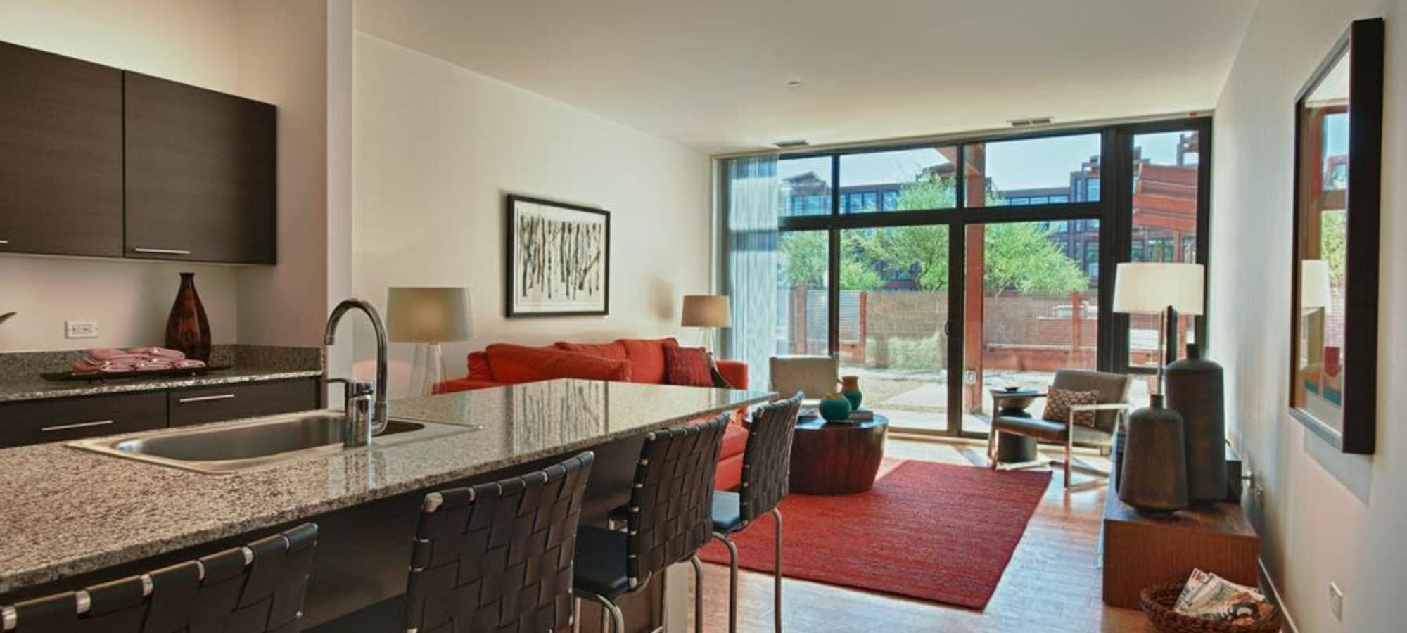 Our apartments in Phoenix, Arizona showcase a luxury living room with a sliding glass door