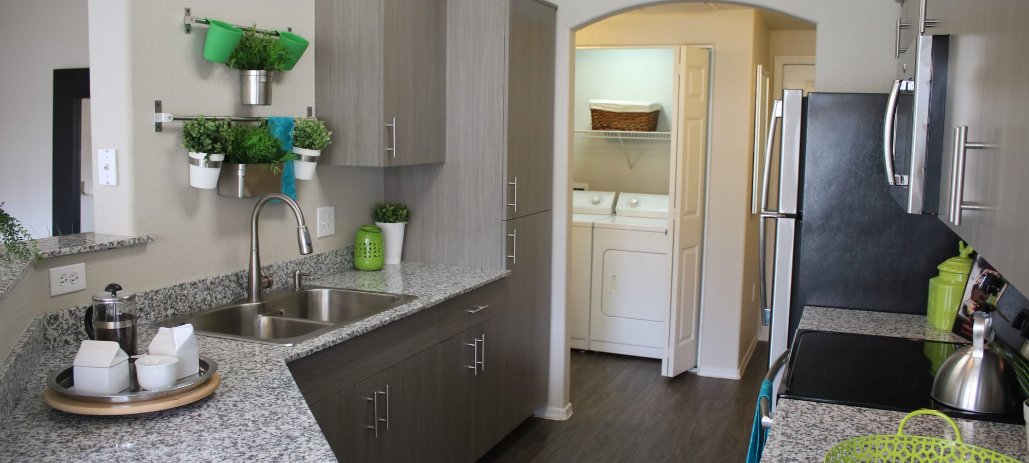 Stainless-steel appliances in the kitchen of a model home at Mira Santi in Chandler, Arizona