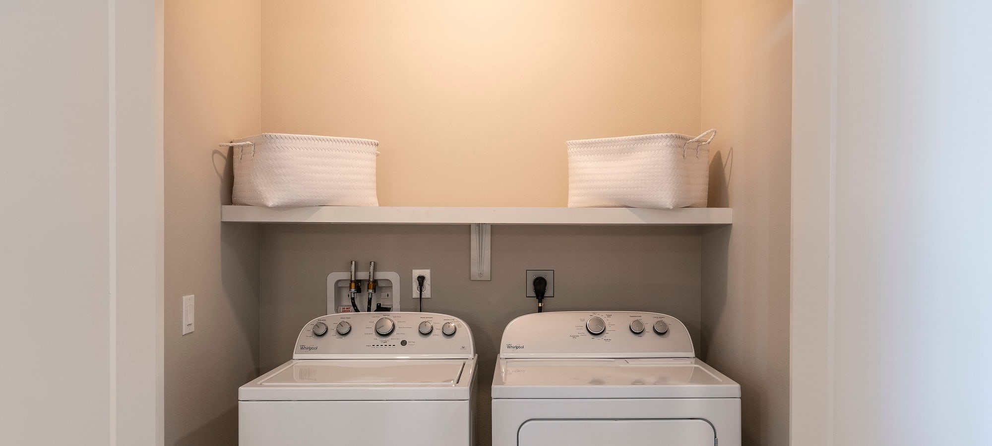 In-unit full-size washer and dryer in a model home at Carter in Scottsdale, Arizona