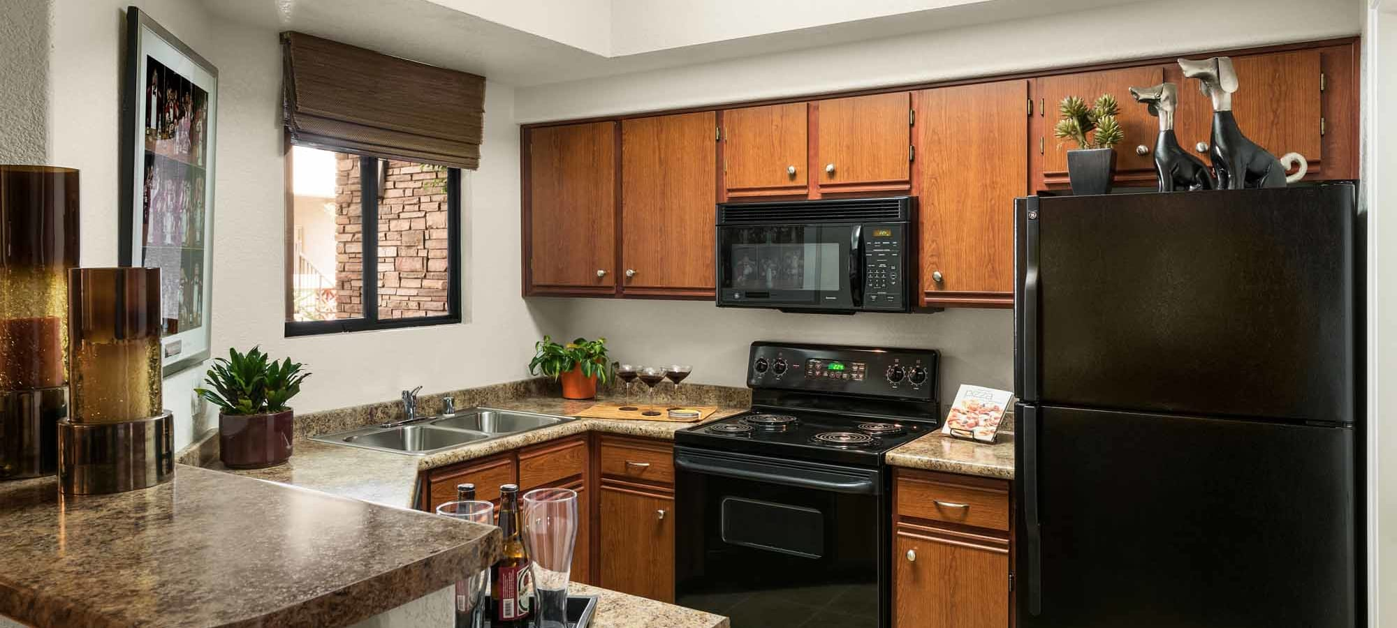Open kitchen with breakfast bar at San Marbeya in Tempe, Arizona