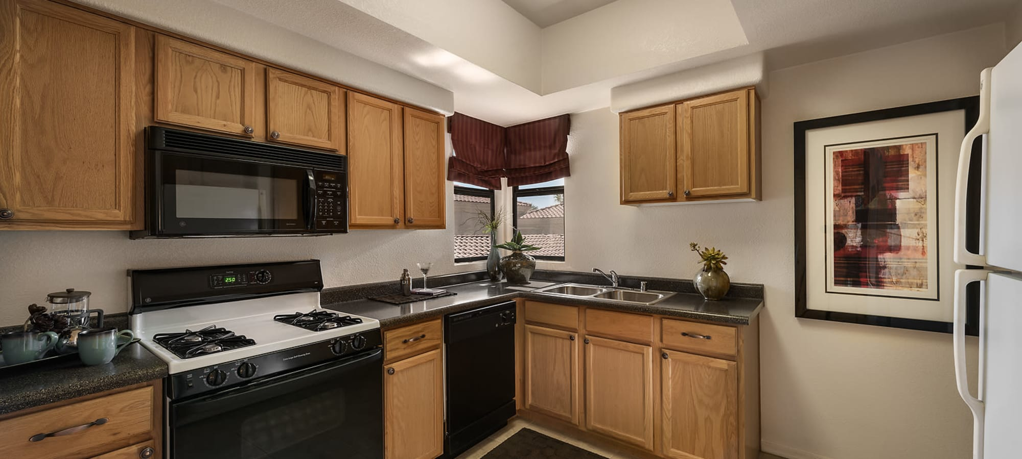 Large kitchen with windows at San Cervantes in Chandler, Arizona