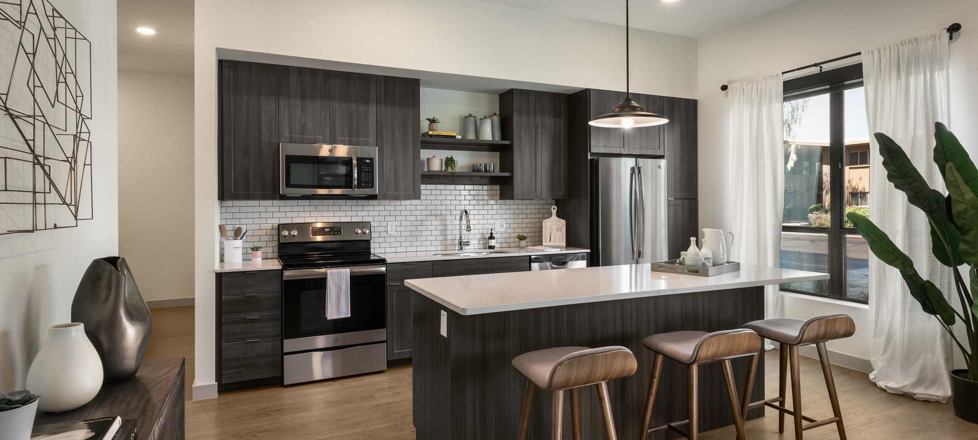 Spacious kitchen with stainless steel appliances at The Astor at Osborn in Phoenix, Arizona