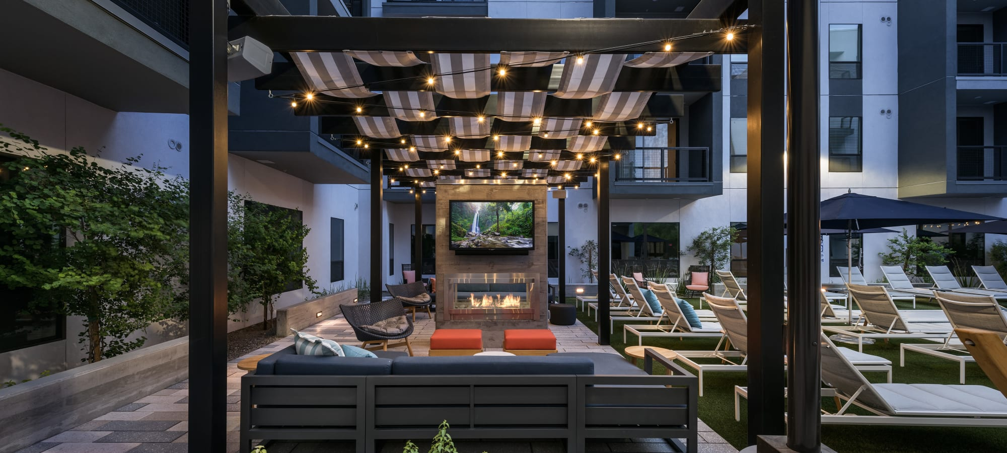 Open covered outdoor seating area with fireplace at The Astor at Osborn in Phoenix, Arizona