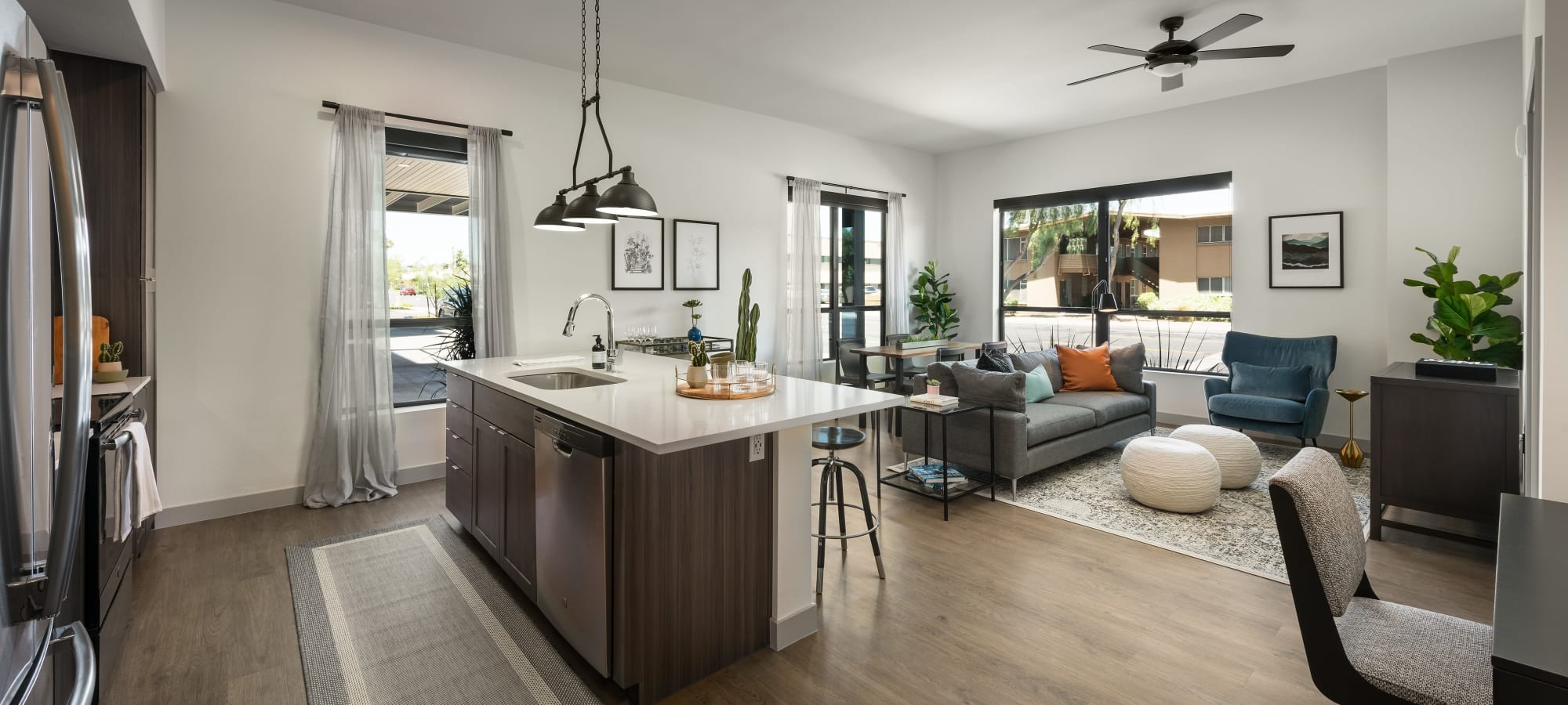 kitchen with island and stainless steel appliances at The Astor at Osborn in Phoenix, Arizona