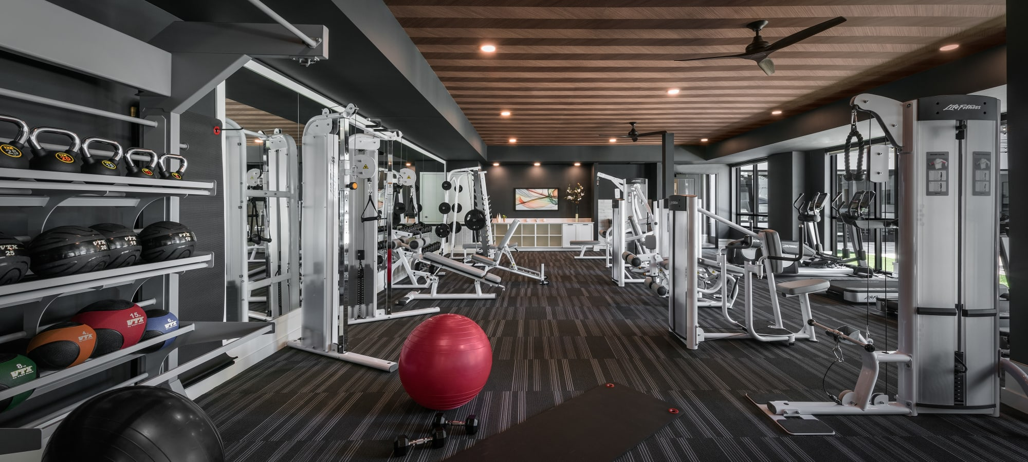 Fitness center with equipment at The Astor at Osborn in Phoenix, Arizona